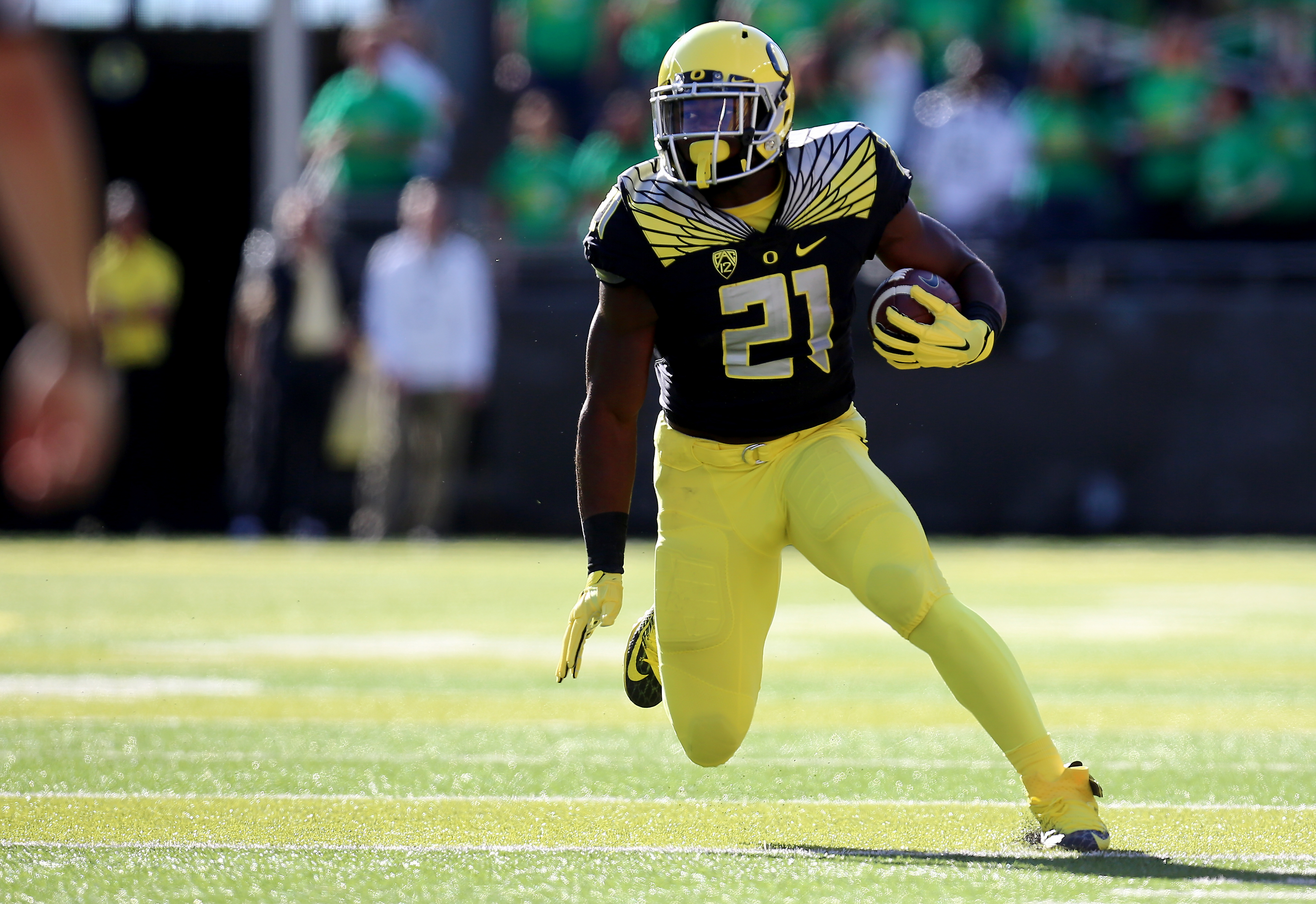 FILE - In this Sept. 5, 2015, file photo, Oregon running back Royce Freeman runs during the first quarter of an NCAA college football game against Eastern Washington, Saturday in Eugene, Ore.   Freeman ran for a career-high 180 yards and three touchdowns