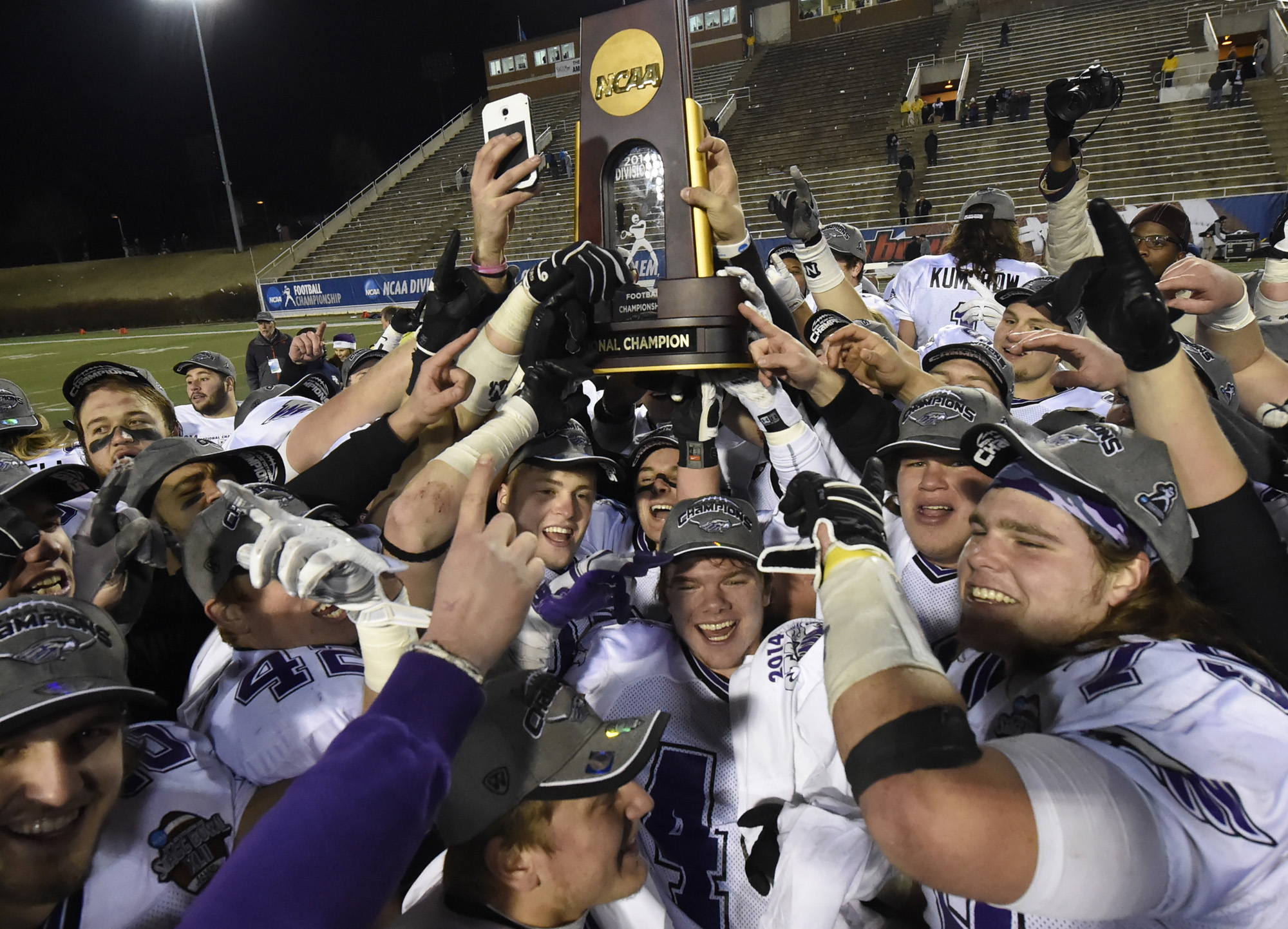 FILE - In this Dec. 19, 2014, file photo, Wisconsin-Whitewater players celebrate after defeating Mount Union 43-34, winning the NCAA Division III championship college football game at Salem Stadium in Salem, Va. One of the biggest selling points that Kevi