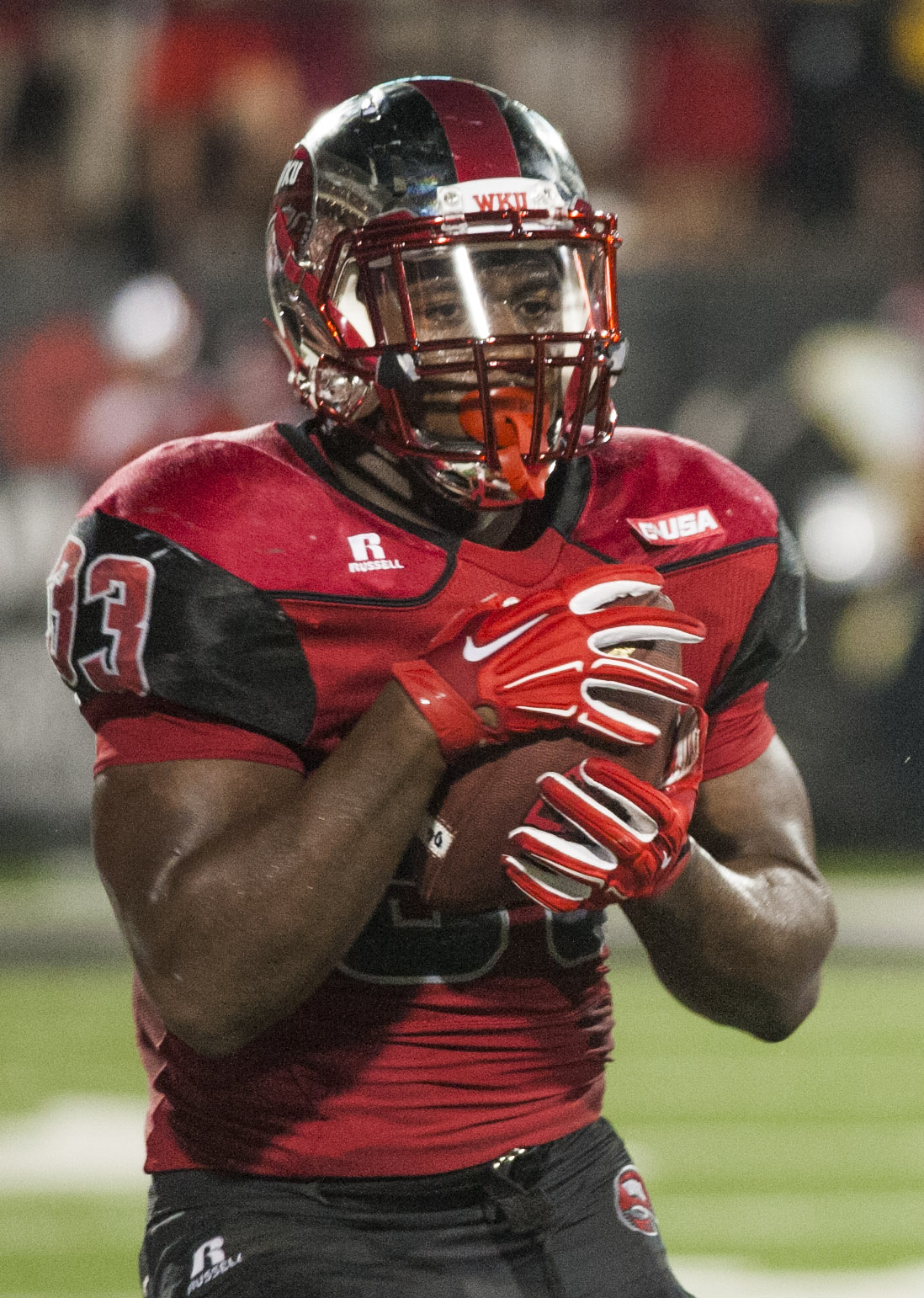 Western Kentucky running back Leon Allen makes a reception during Western Kentucky's 41-38 win over Louisiana Tech in an NCAA college football game Thursday, Sept. 10, 2015, in Bowling Green, Ky. (Austin Anthony/Daily News via AP)