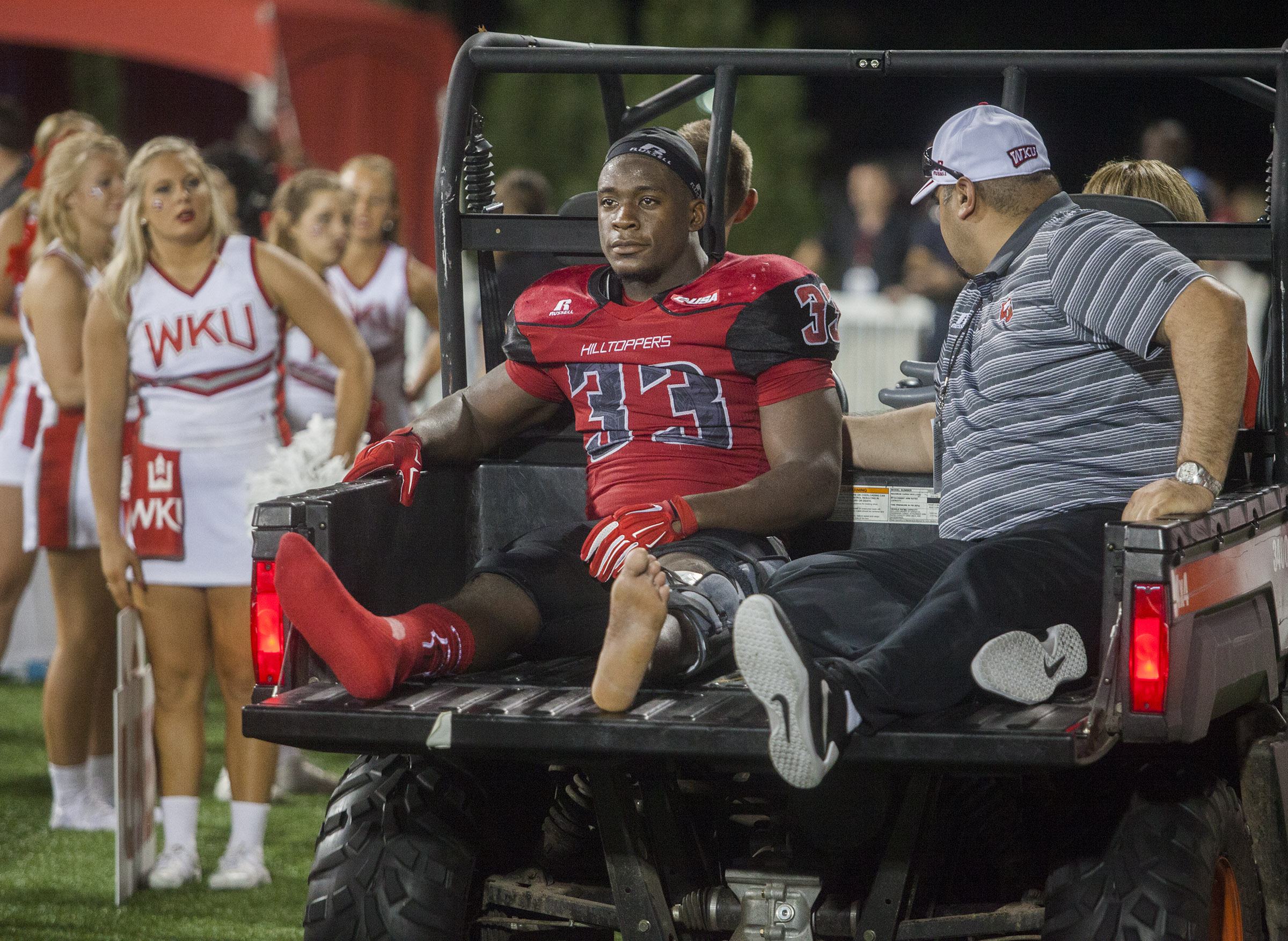Western Kentucky running back Leon Allen is taken out of the stadium after a leg injury during Western Kentucky's 41-38 win over Louisiana Tech in an NCAA college football game Thursday, Sept. 10, 2015, in Bowling Green, Ky. (Austin Anthony/Daily News via