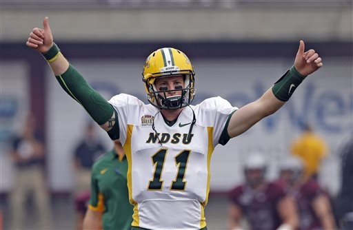 North Dakota State quarterback Carson Wentz (11) warms up before the start of their NCAA college football game against Montana Saturday, Aug. 29, 2015, in Missoula, in Mont.  (AP Photo/Rick Bowmer)