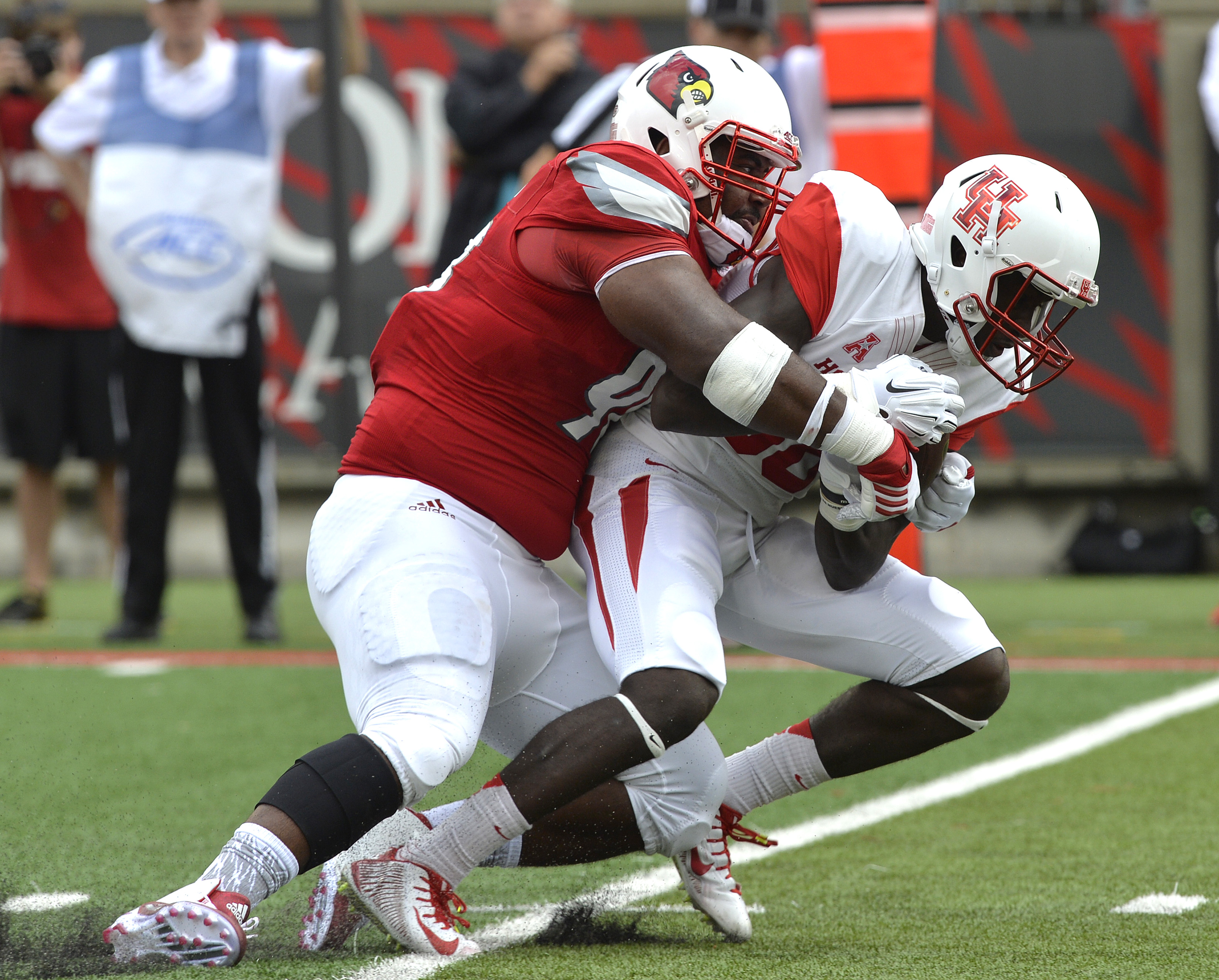 Louisville's Sheldon Rankins (98), brings down Houston's Steven Dunbar (88) during the first half of an NCAA college football game in Louisville, Ky. Saturday, Sept. 12, 2015. (AP Photo/Timothy D. Easley)