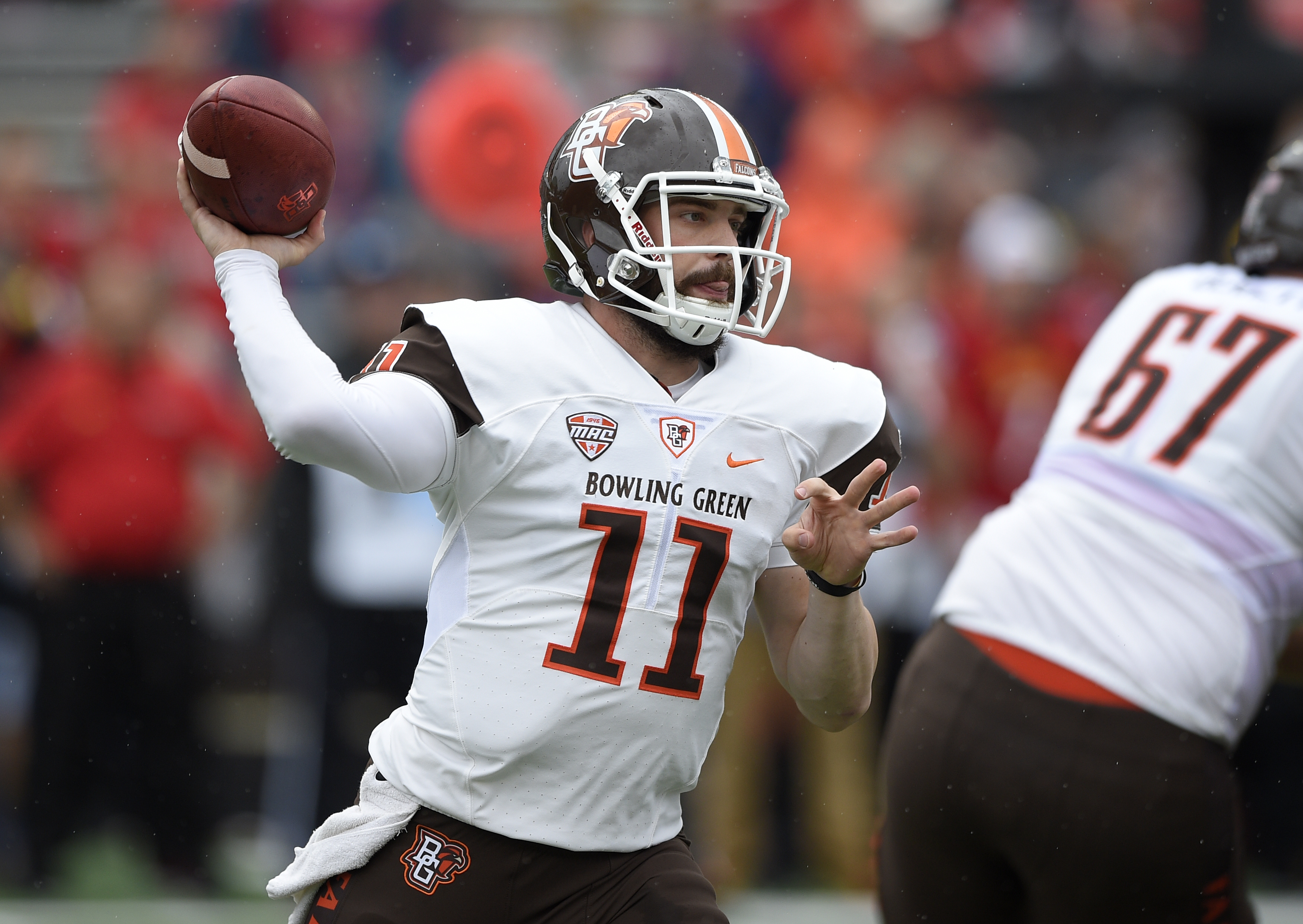 Bowling Green quarterback Matt Johnson (11) throws a pass against Maryland during the first half of an NCAA college football game, Saturday, Sept. 12, 2015, in College Park, Md. (AP Photo/Nick Wass)