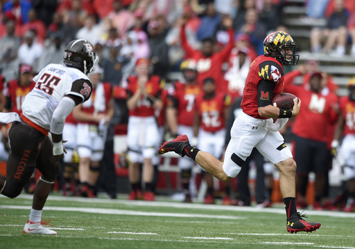 Maryland quarterback Perry Hills, right, runs with the ball past Bowling Green linebacker James Sanford (35) during the first half of an NCAA college football game, Saturday, Sept. 12, 2015, in College Park, Md. (AP Photo/Nick Wass)
