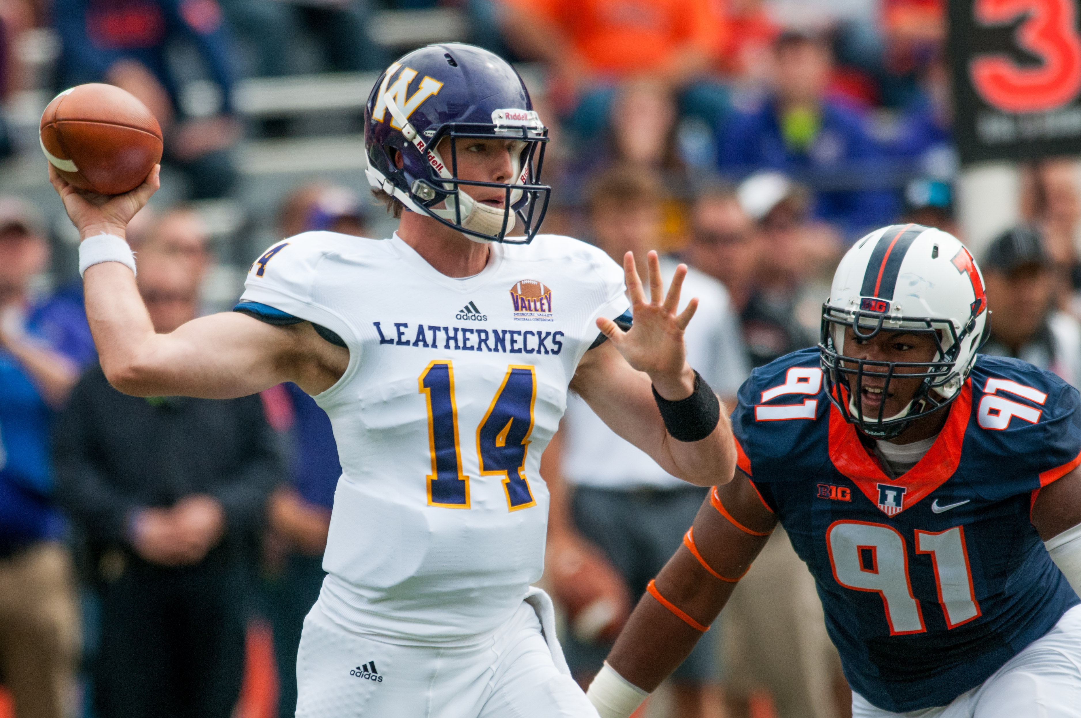 Western Illinois quarterback Trenton Norvell (14) throws a pass as Illinois defensive end Dawuane Smoot (91) pursues during the first quarter of an NCAA college football game Saturday, Sept. 12, 2015, at Memorial Stadium in Champaign, Ill. (AP Photo/Bradl