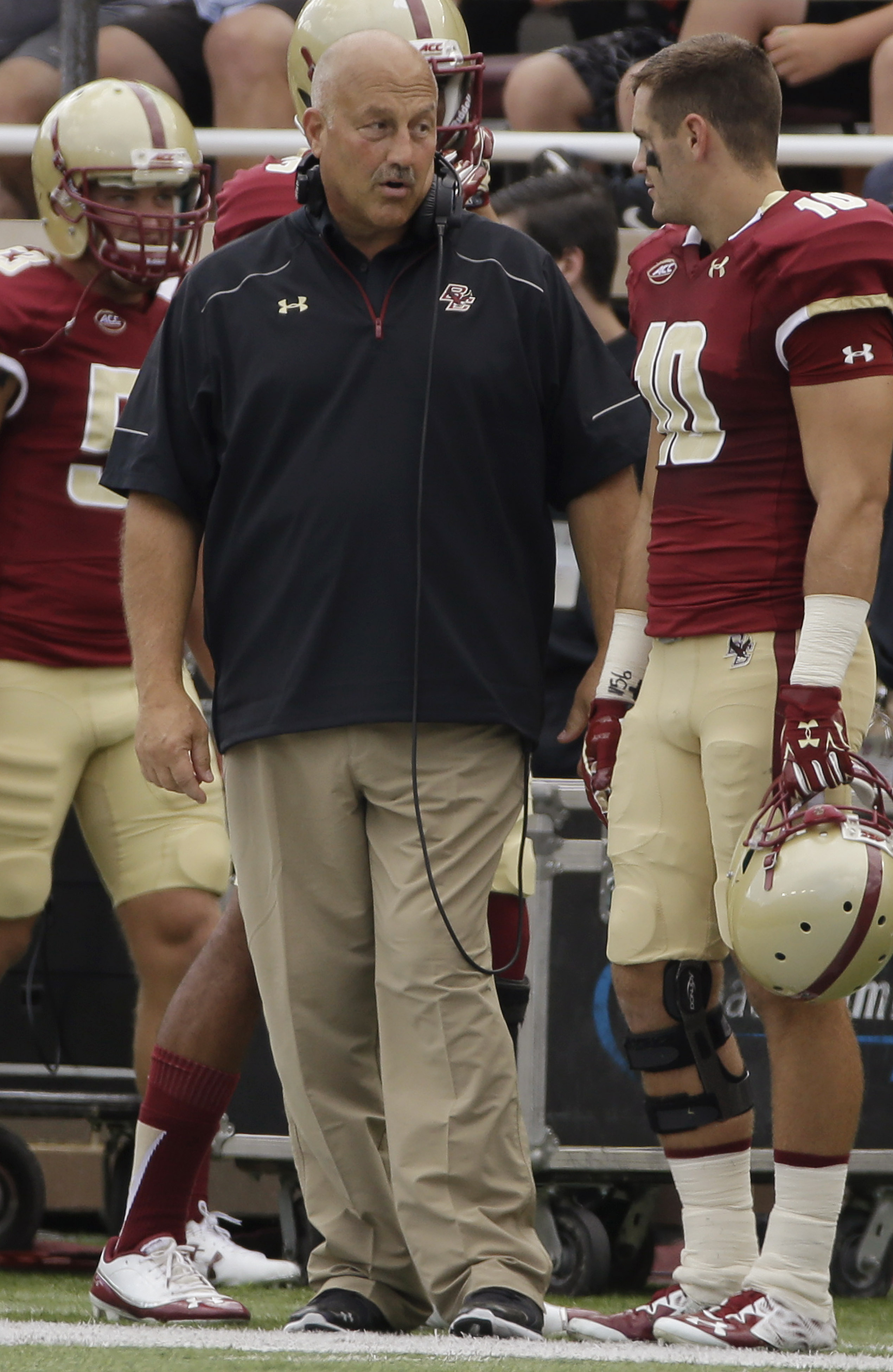 Boston College head coach Steve Addazio watches his team take a large lead over Howard during the first half of an NCAA college football game, Saturday, Sept. 12, 2015, in Boston, Mass. (AP Photo/Stephan Savoia)