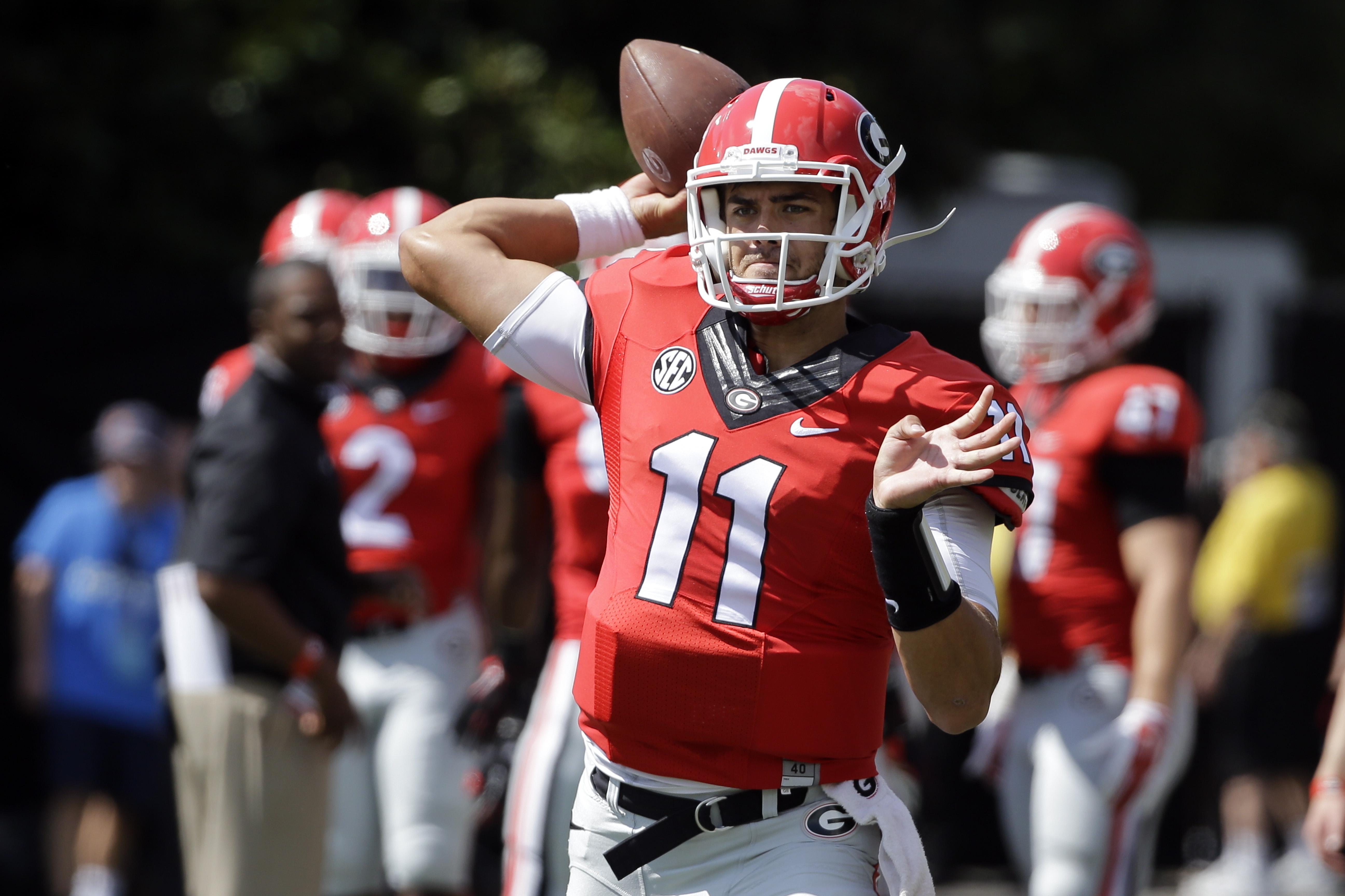 Georgia quarterback Greyson Lambert warms up before the start of an NCAA college football game against Vanderbilt Saturday, Sept. 12, 2015, in Nashville, Tenn. (AP Photo/Mark Humphrey)