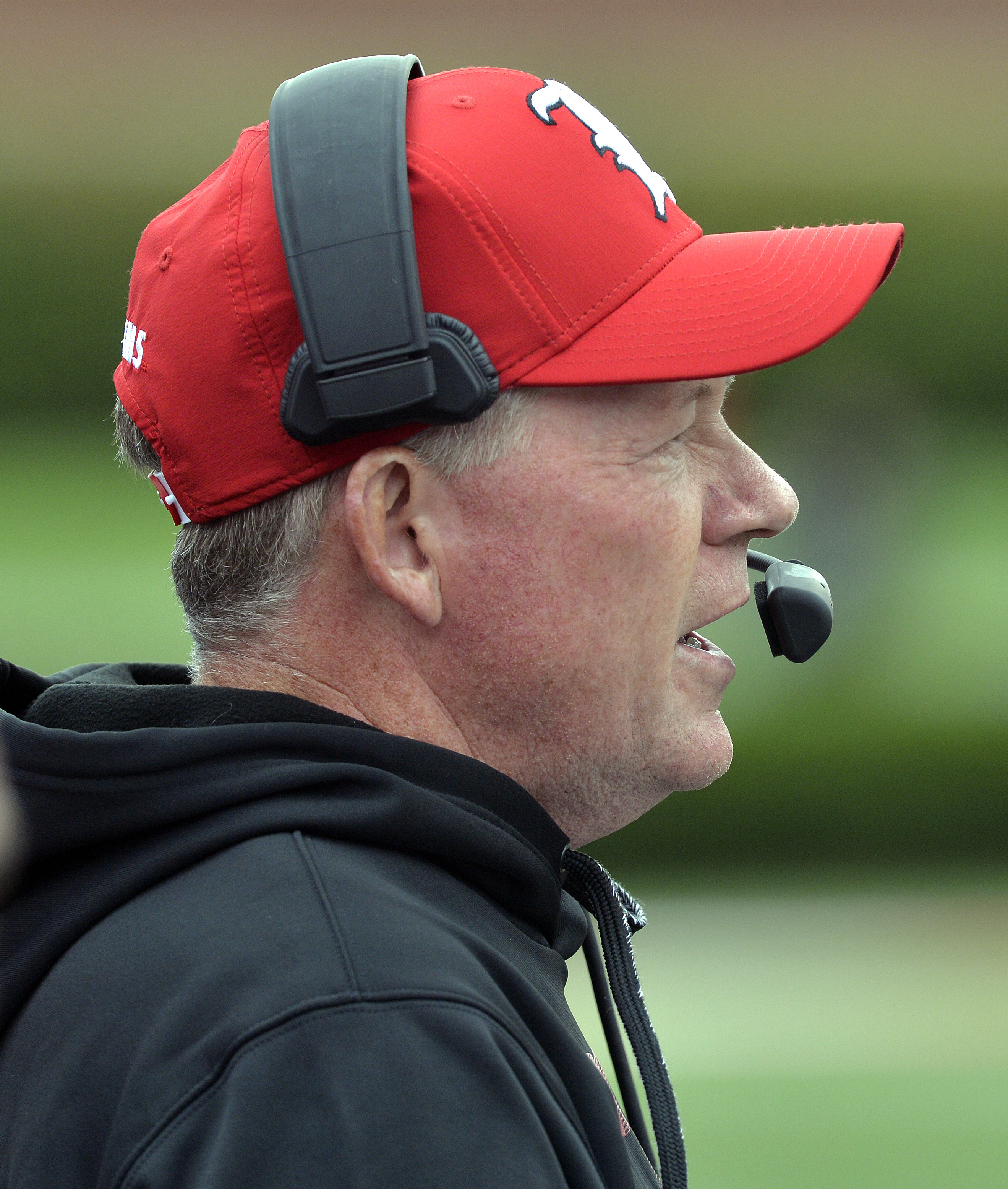 Louisville head coach Bobby Petrino sends instructions in to his offense during the second half of an NCAA college football game in Louisville, Ky. Saturday, Sept. 12, 2015. Houston defeated Louisville 34-31. (AP Photo/Timothy D. Easley)
