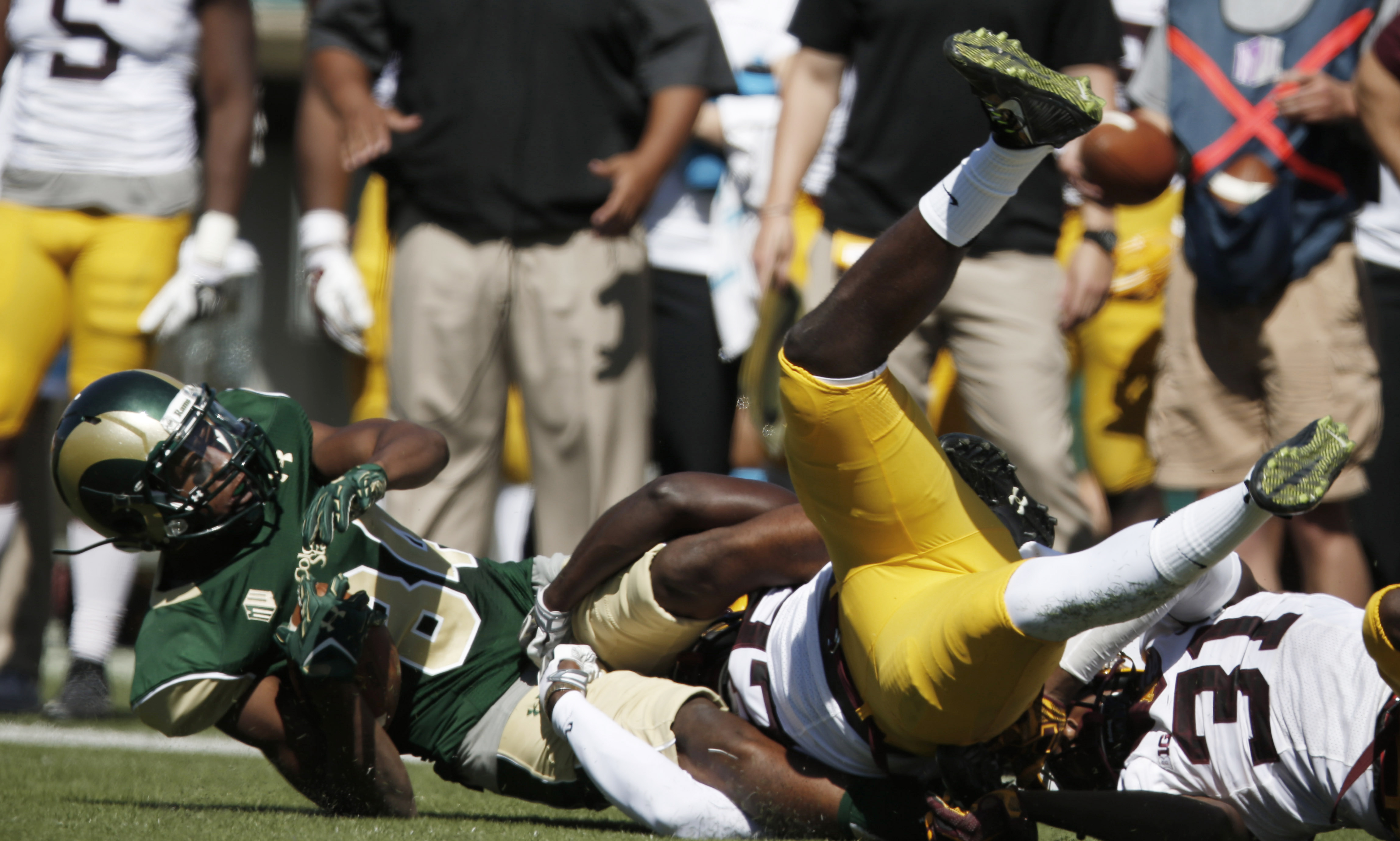 Colorado State wide receiver Xavier Williams, left, is pulled down after making a pass reception by Minnesota linebacker De'Vondre Campbell in the second quarter of an NCAA college football game Saturday, Sept. 12, 2015, in Fort Collins, Colo. (AP Photo/D