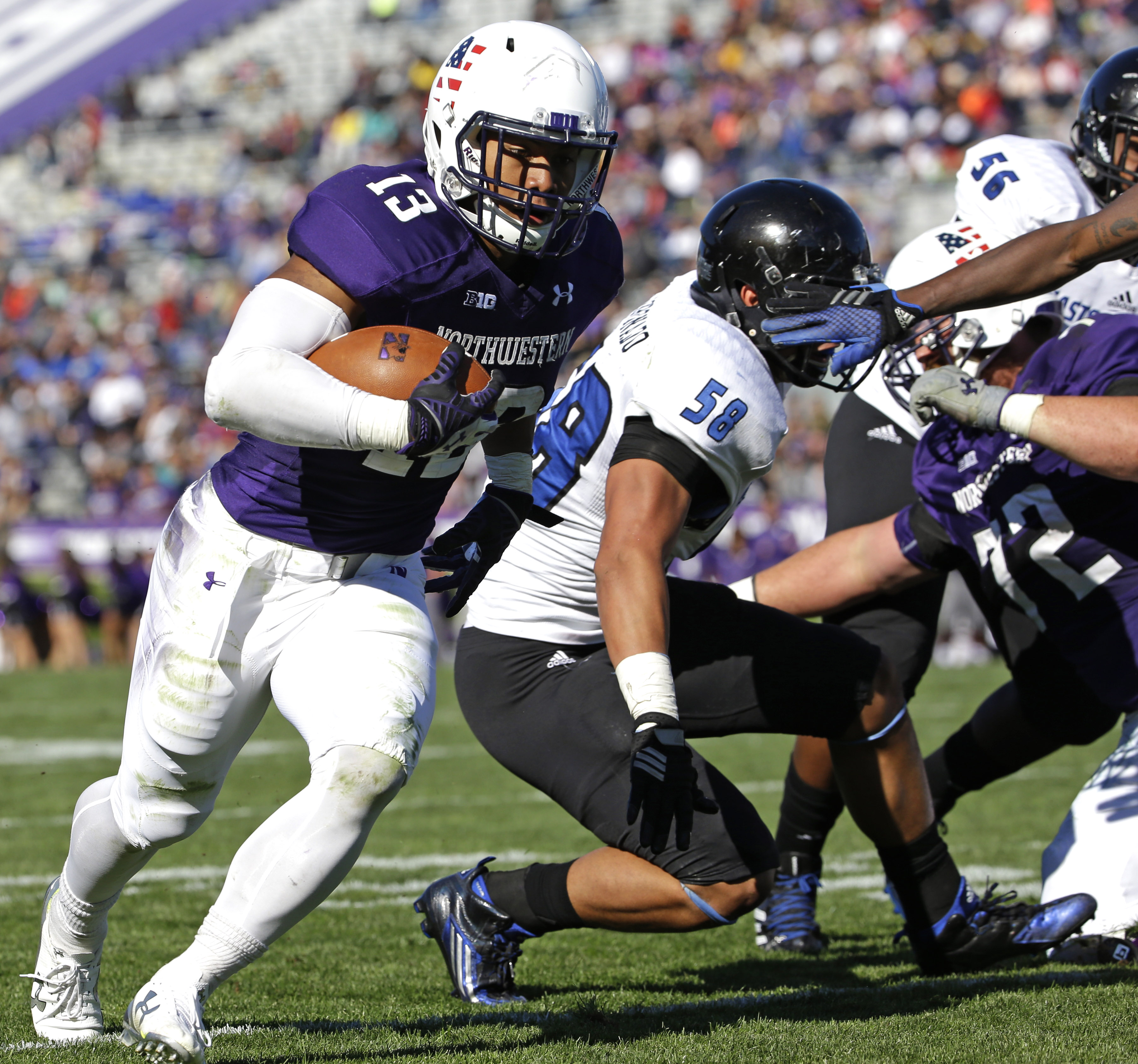 Northwestern running back Warren Long scores a touchdown during the first half of an NCAA college football game against Eastern Illinois, Saturday, Sept. 12, 2015, in Evanston, Ill. (AP Photo/Nam Y. Huh)
