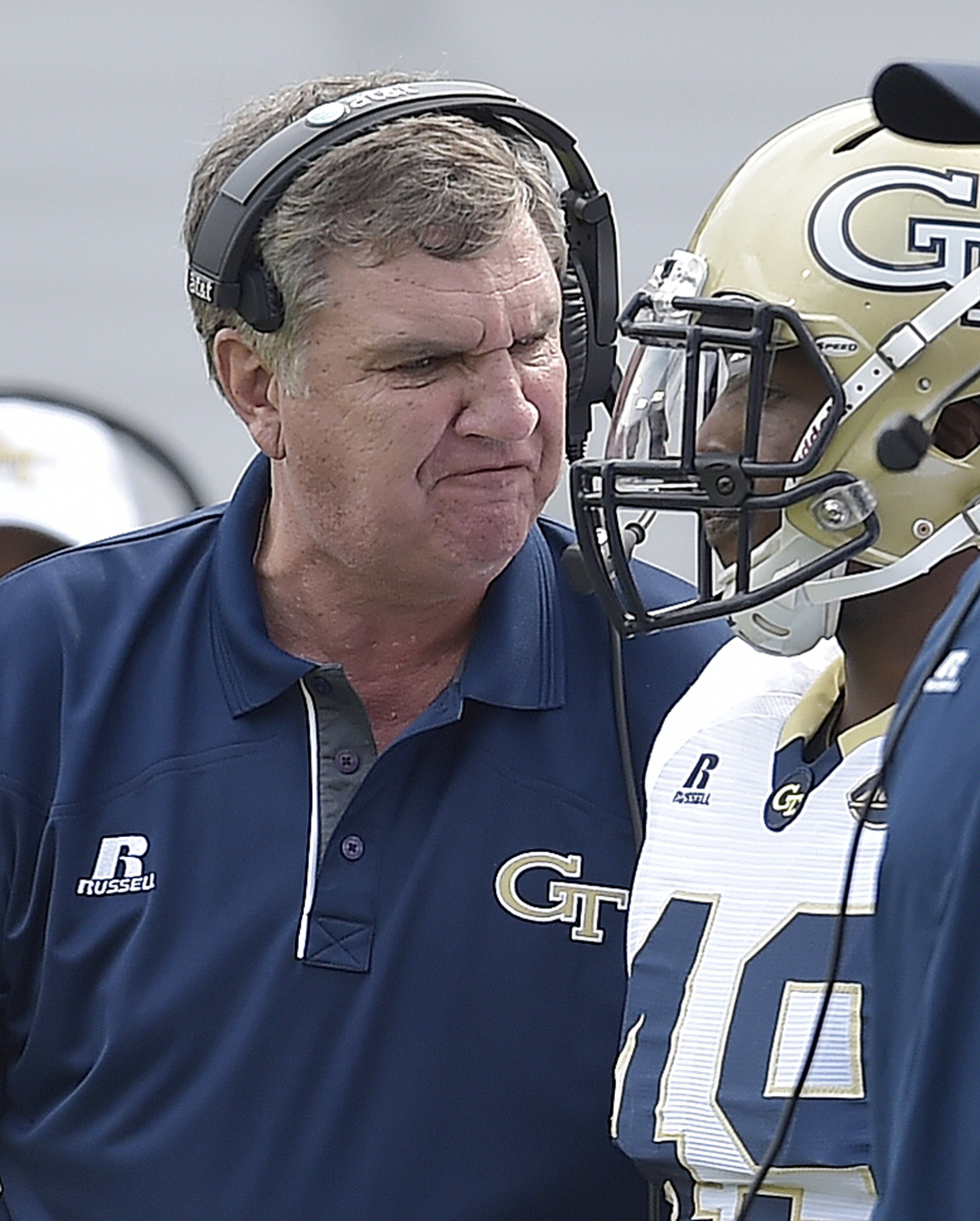Georgia Tech head coach Paul Johnson speaks to a player on the sideline against Tulane during the first half of an NCAA college football game, Saturday, Sept. 12, 2015, in Atlanta. (AP Photo/Mike Stewart)