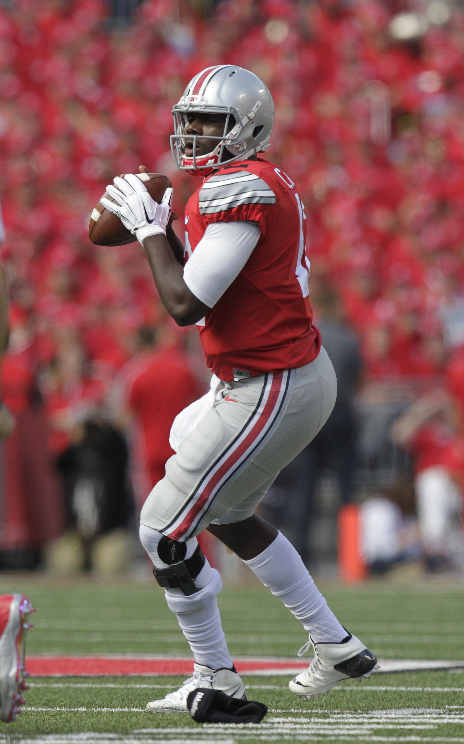 Ohio State quarterback Cardale Jones drops back to pass against Hawaii during the second quarter of an NCAA college football game Saturday, Sept. 12, 2015, in Columbus, Ohio. (AP Photo/Jay LaPrete)
