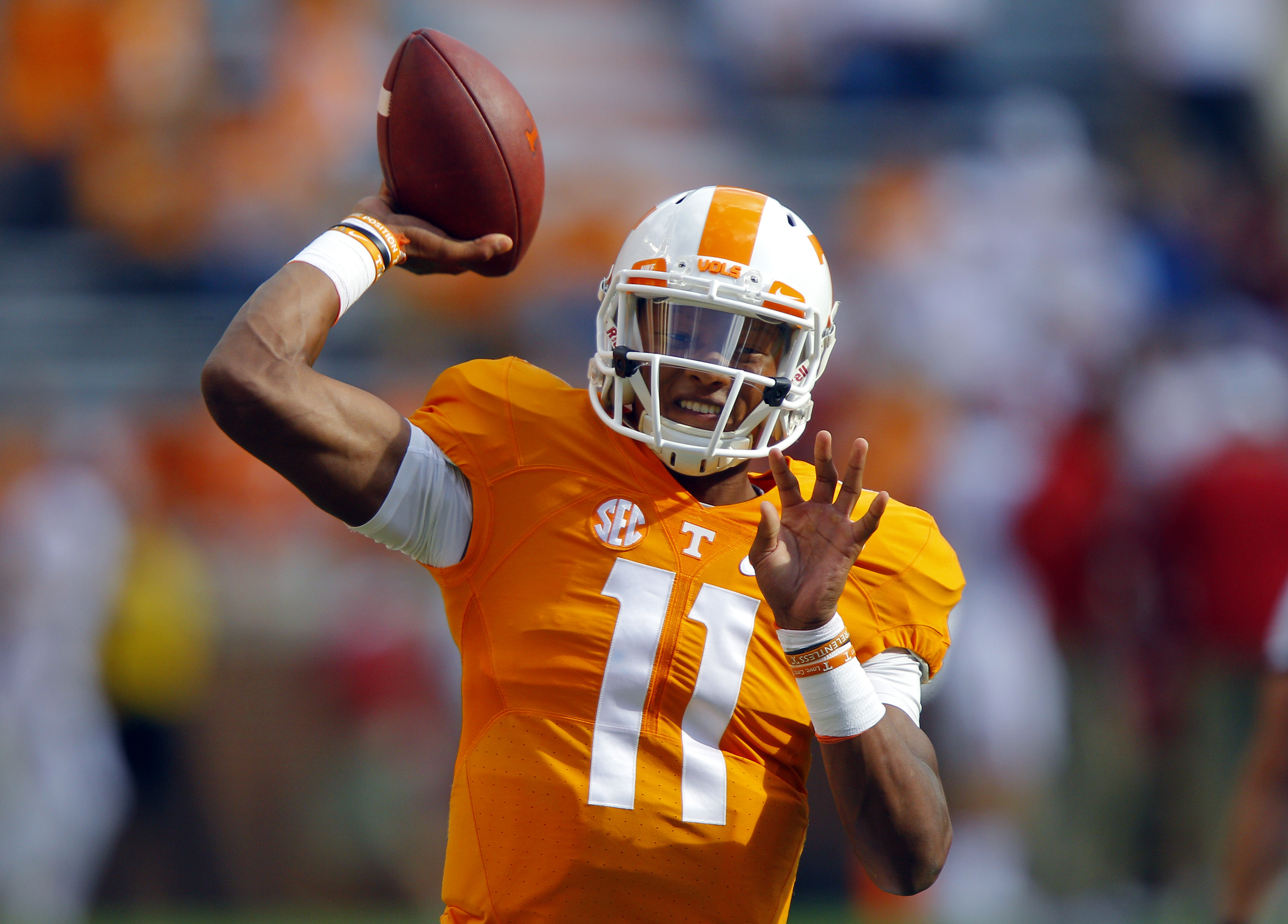 Tennessee quarterback Joshua Dobbs (11) warms up before the start of an NCAA college football game against Oklahoma, Saturday, Sept. 12, 2015 in Knoxville, Tenn. (AP Photo/Wade Payne)