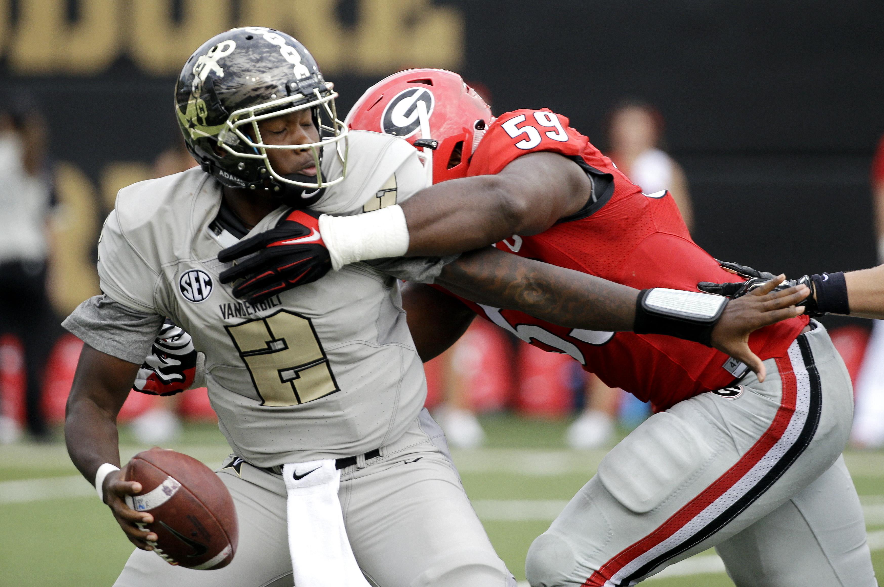 Vanderbilt quarterback Johnny McCrary (2) is sacked by Georgia linebacker Jordan Jenkins (59) for a 7-yard loss in the first half of an NCAA college football game Saturday, Sept. 12, 2015, in Nashville, Tenn. (AP Photo/Mark Humphrey)