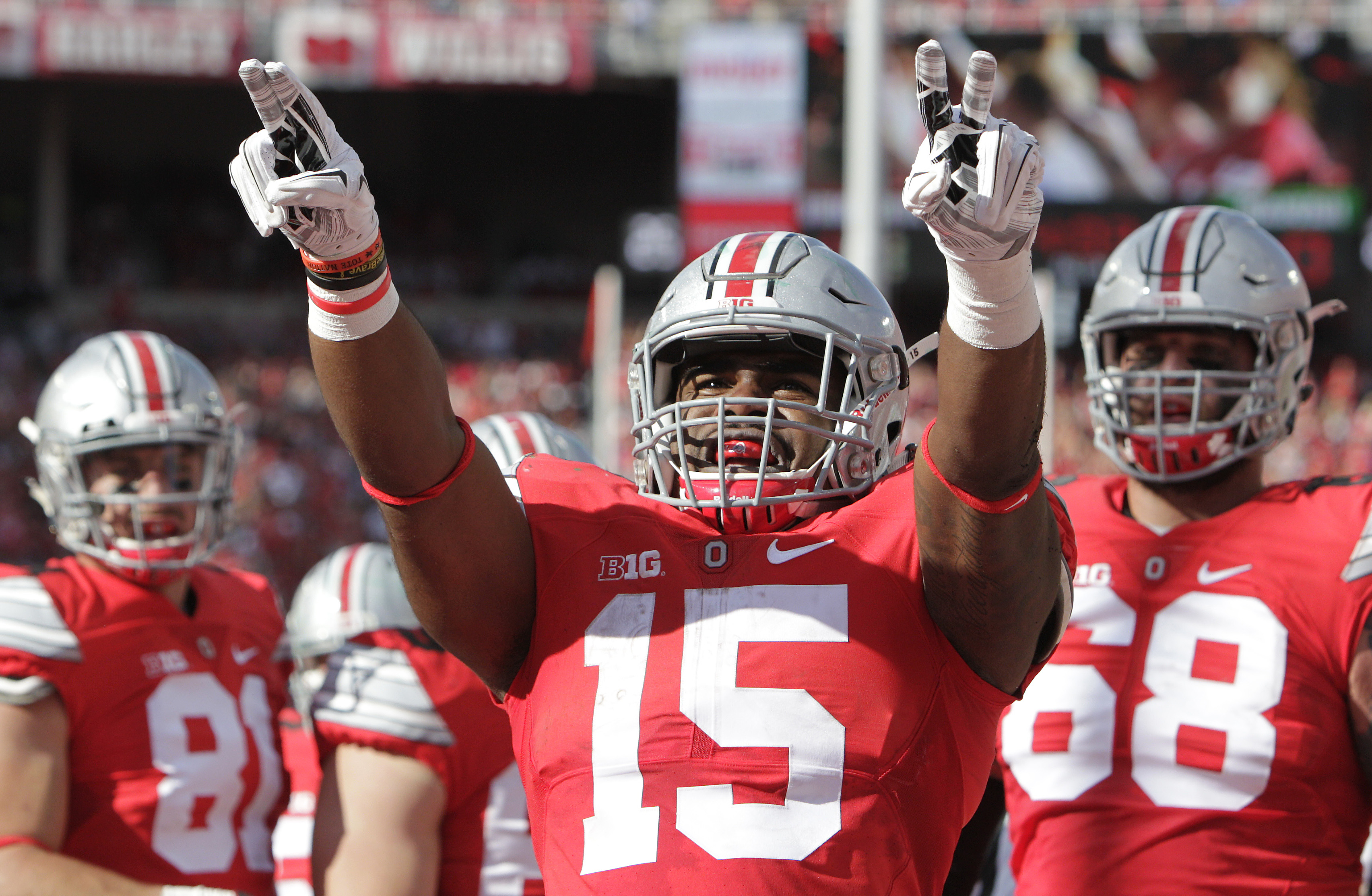 Ohio State running back Ezekiel Elliott celebrates his touchdown against Hawaii during the second quarter of an NCAA college football game Saturday, Sept. 12, 2015, in Columbus, Ohio. (AP Photo/Jay LaPrete)
