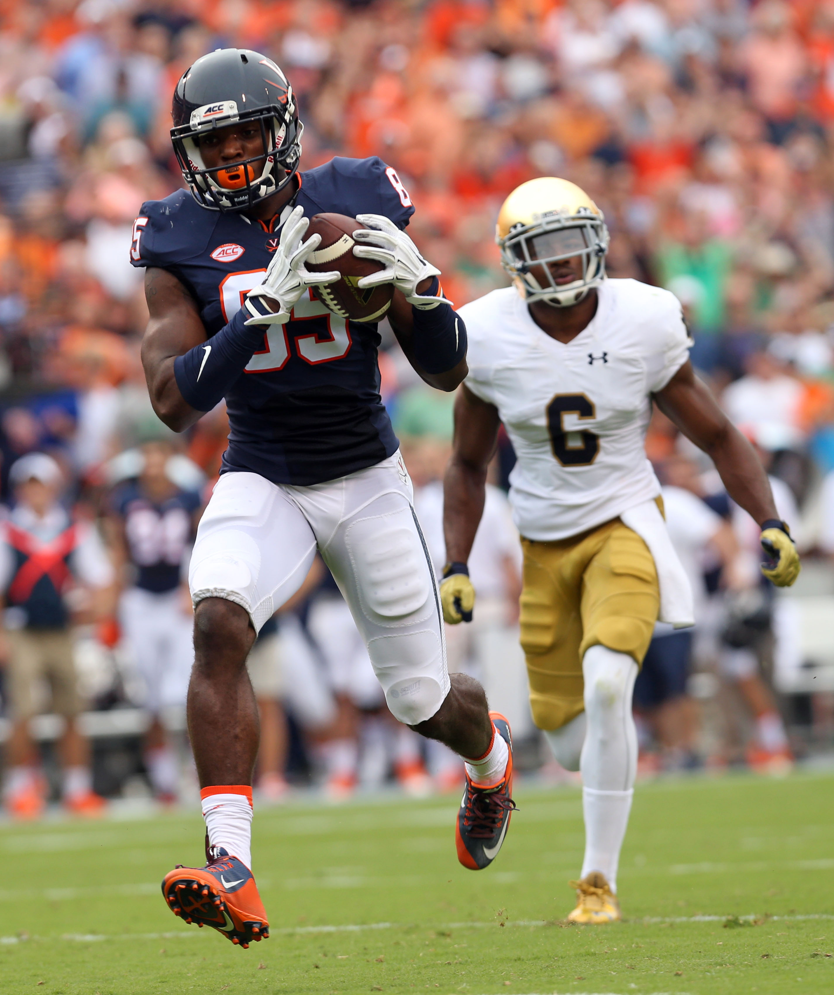 Virginia wide receiver Keeon Johnson (85) runs in a touchdown pass in front of Notre Dame cornerback KeiVarae Russell (6) during an NCAA college football game Saturday, Sept. 12, 2015, in Charlottesville, Va. (AP Photo/Andrew Shurtleff)