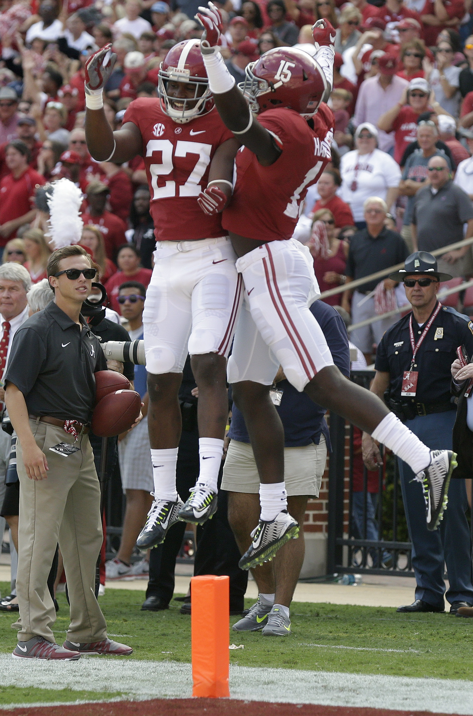 Alabama defensive back Ronnie Harrison (15) and defensive back Shawn Burgess-Becker (27) celebrate after Harrison blocked the punt against Middle Tennessee Trevor Owens  punter (43) in the first half of an NCAA college football game, Saturday, Sept. 12, 2