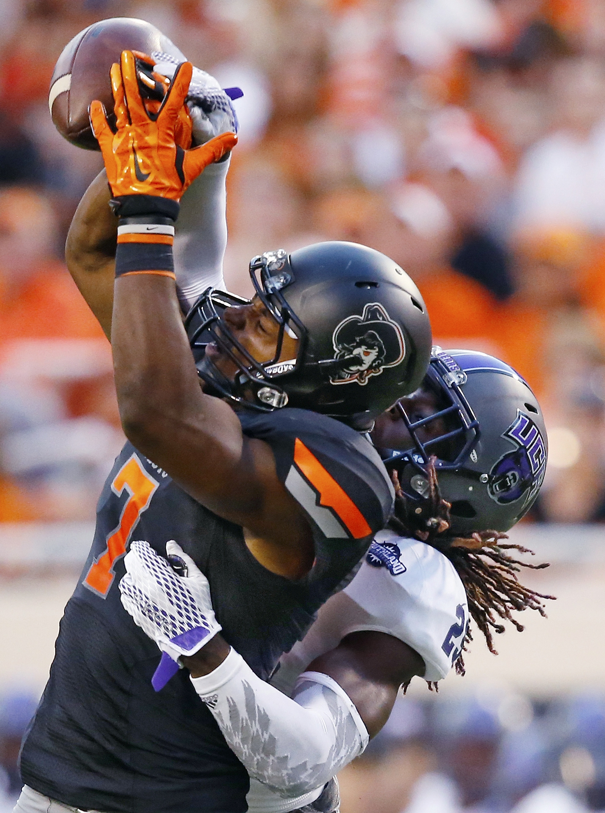 Central Arkansas cornerback Tremon Smith (29) breaks up a pass intended for Oklahoma State wide receiver Brandon Sheperd (7) in the second quarter of an NCAA college football game in Stillwater, Okla., Saturday, Sept. 12, 2015. (AP Photo/Sue Ogrocki)