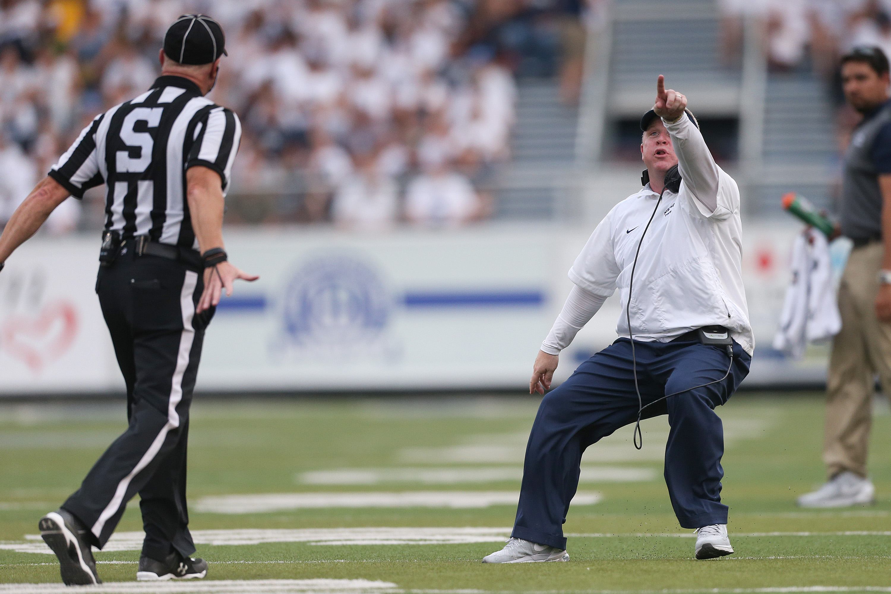 Nevada coach Brian Polian argues with an official over the remaining time during the first half against Arizona in an NCAA college football game in Reno, Nev., on Saturday, Sept. 12, 2015. (AP Photo/Cathleen Allison)
