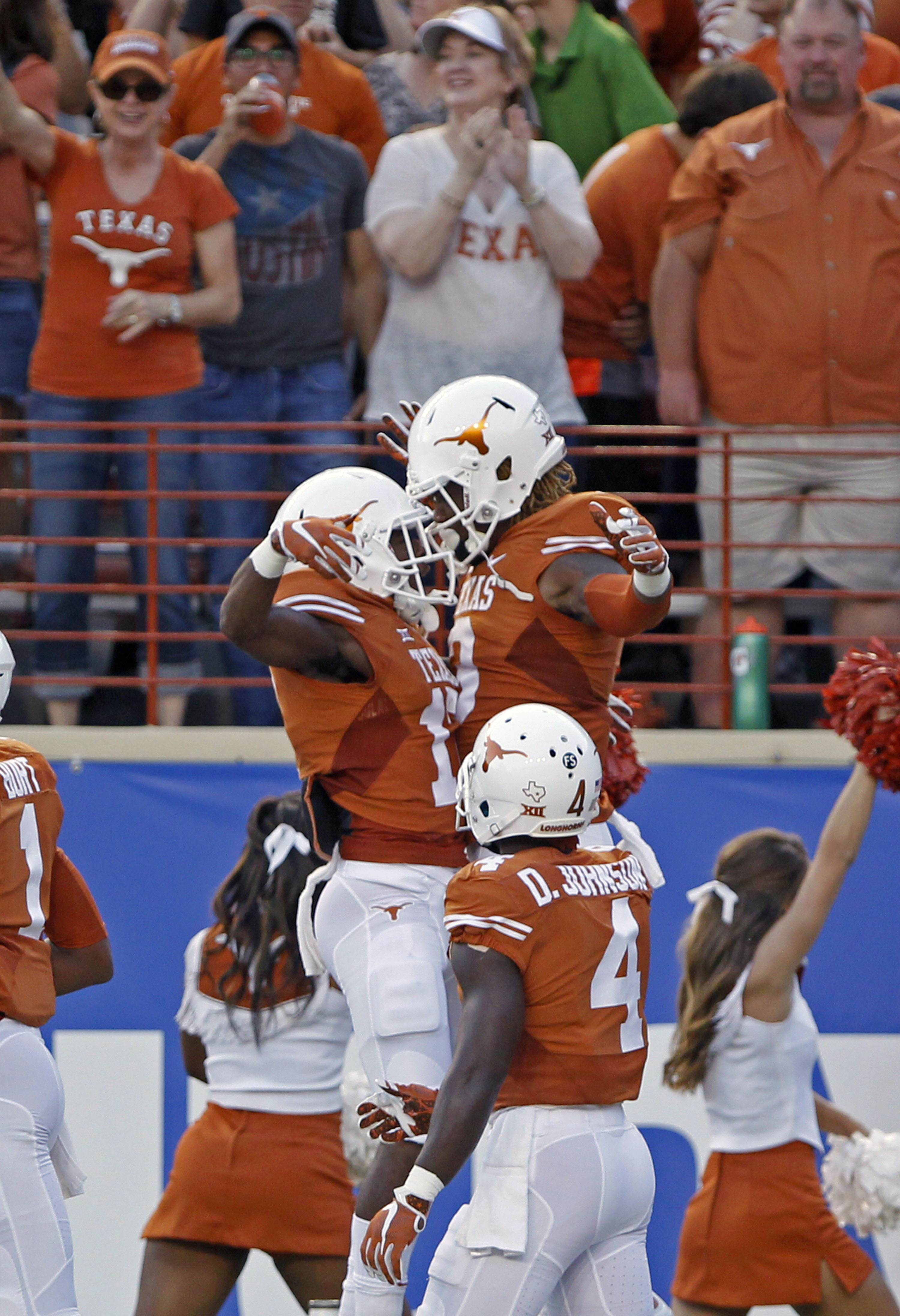 Texas wide receiver Armanti Foreman, right, celebrates his touchdown reception with teammate Ryan Newsome, left, during the first half of an NCAA college football game against Rice, Saturday, Sept. 12, 2015, in Austin, Texas. (AP Photo/Michael Thomas)