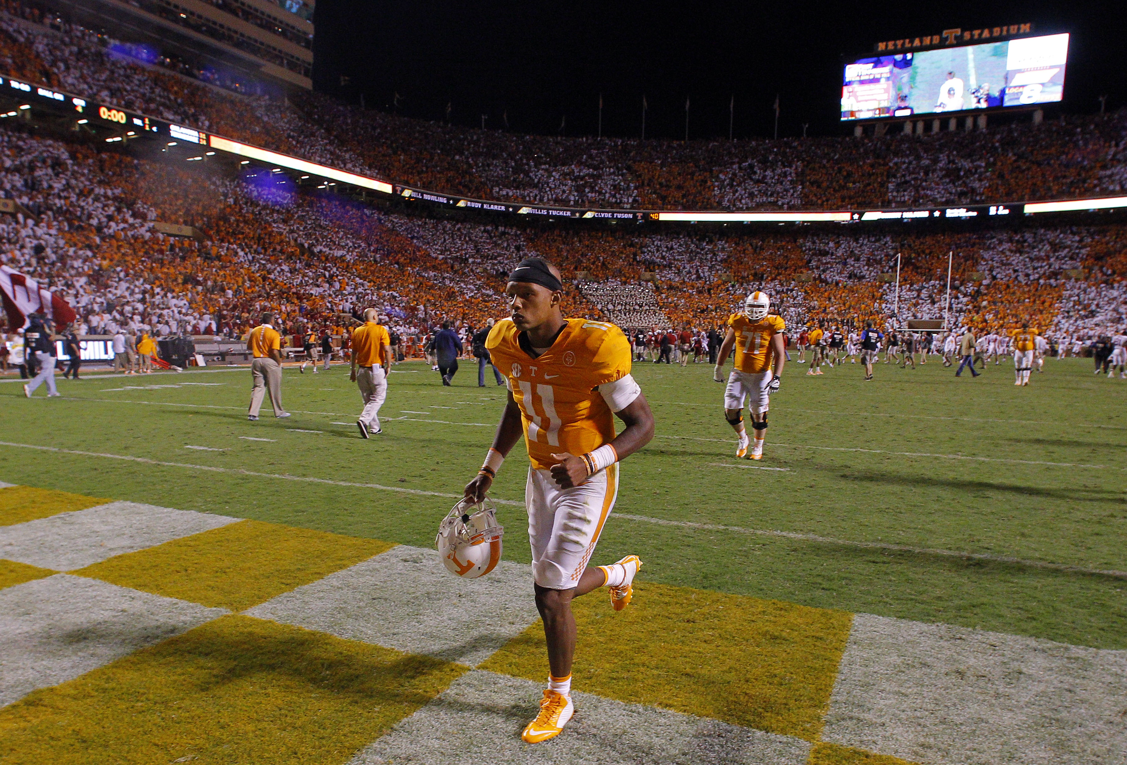 Tennessee quarterback Joshua Dobbs (11) leaves the field after a 31-24 loss to Oklahoma in double overtime of an NCAA college football game Saturday, Sept. 12, 2015 in Knoxville, Tenn. (AP Photo/Wade Payne)