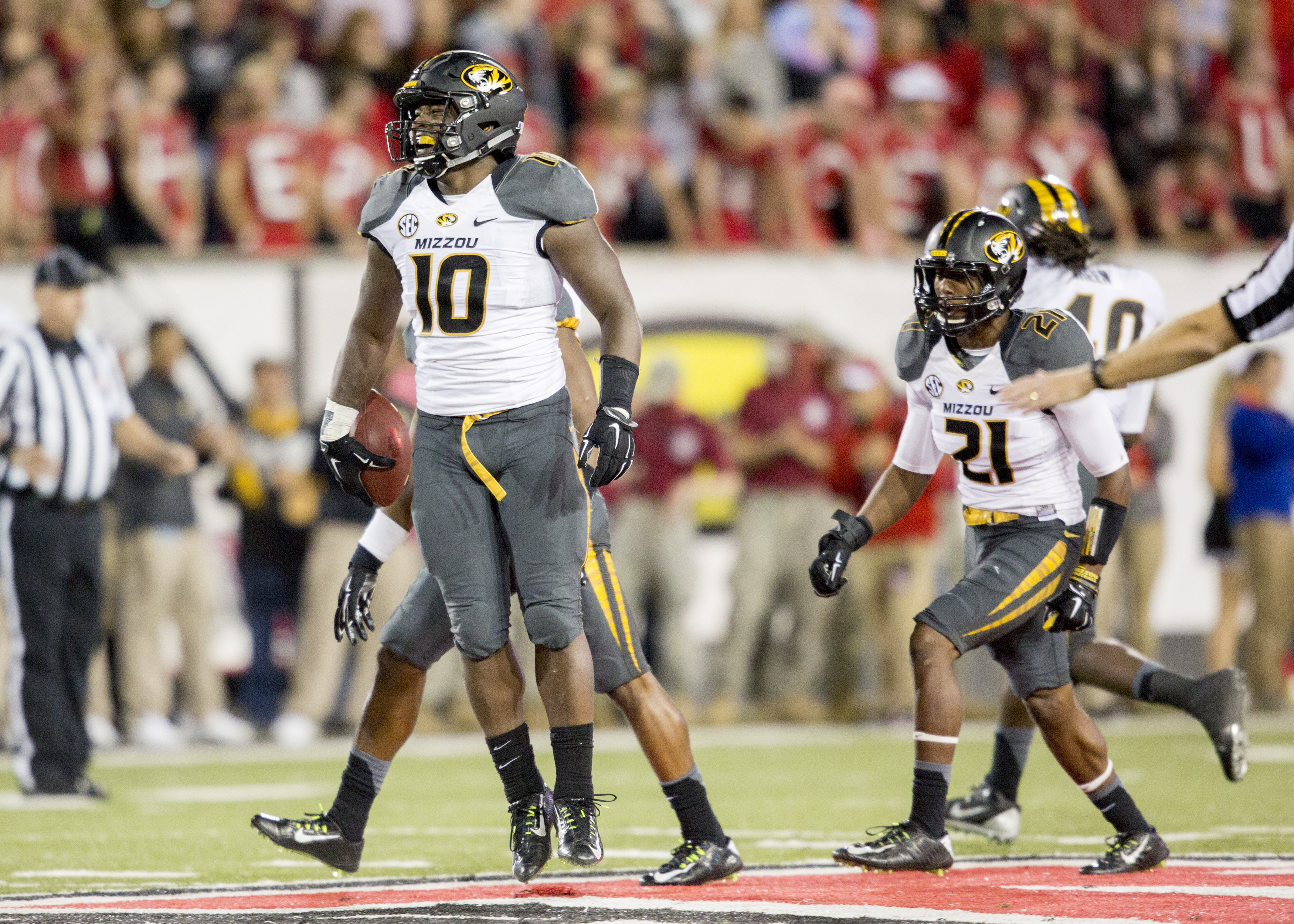 Missouri linebacker Kentrell Brothers (10) celebrates with the defense after he intercepted an Arkansas State pass during the second half of an NCAA college football game, Saturday, Sept. 12, 2015, in Jonesboro, Ark. (AP Photo/Gareth Patterson)