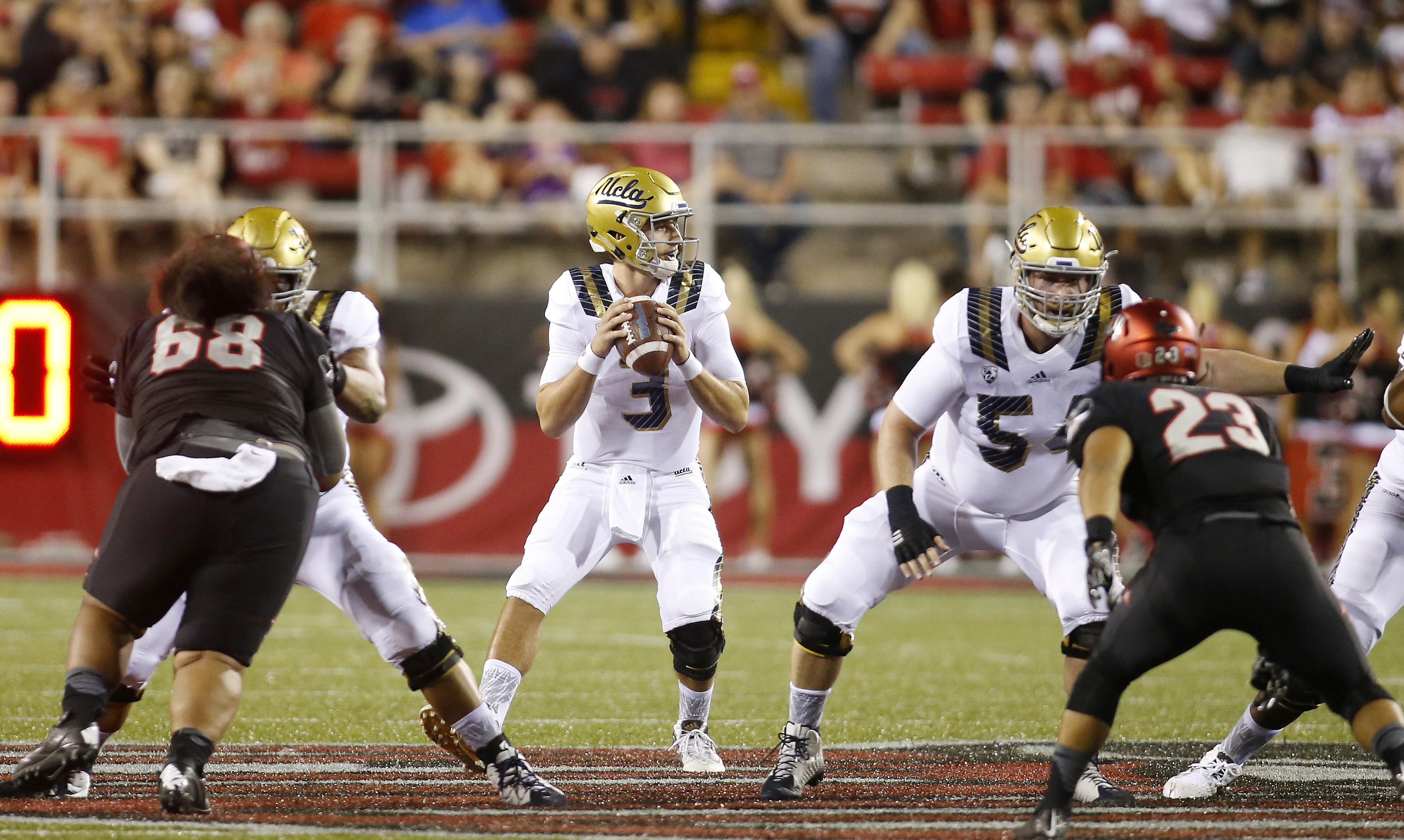 UCLA quarterback Josh Rosen drops back to pass during the first half of an NCAA football game against UNLV, Saturday, Sept. 12, 2015, in Las Vegas. (AP Photo/Isaac Brekken)