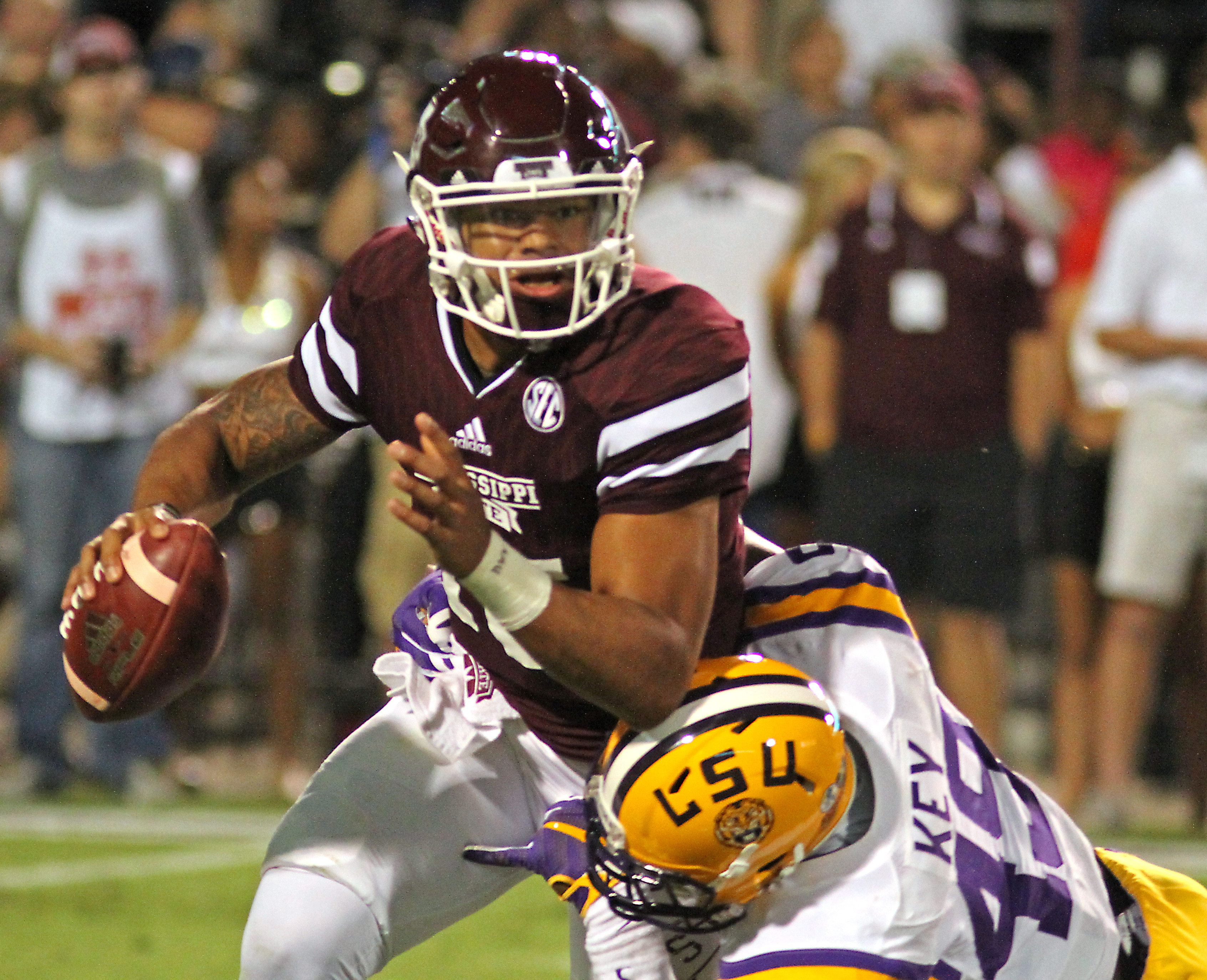Mississippi State quarterback Dak Prescott, left, is sacked by LSU defender Arden Key, right, during the first half of an NCAA college football game in Starkville, Miss., on Sat., Sept 12, 2015, LSU won 21-19.  (AP Photo/Jim Lytle)