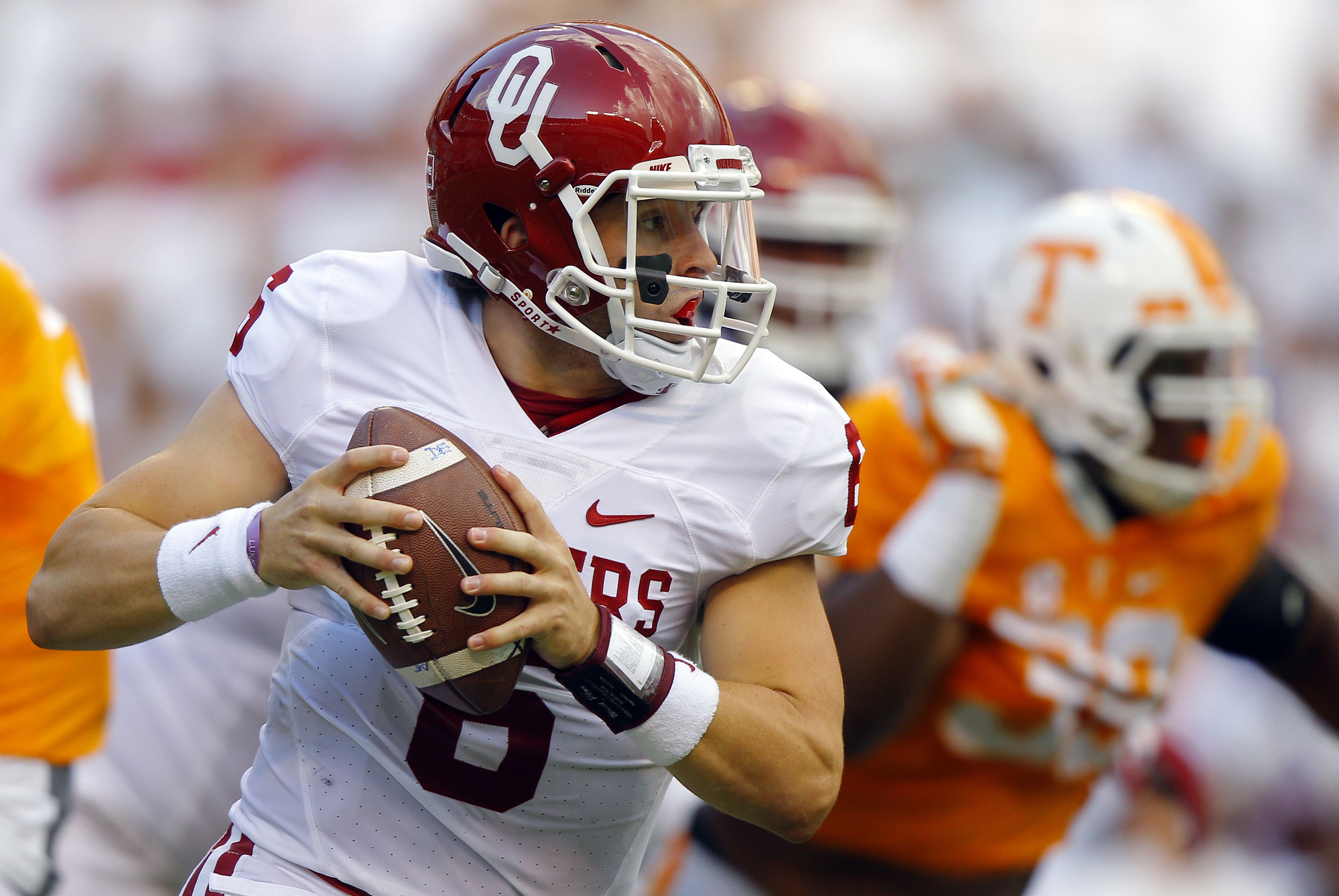 FILE - In this Saturday, Sept. 12, 2015, file photo, Oklahoma quarterback Baker Mayfield (6) runs for yardage during the first half of an NCAA college football game against Tennessee in Knoxville, Tenn. For years, Mayfield dreamed of creating dramatic vic
