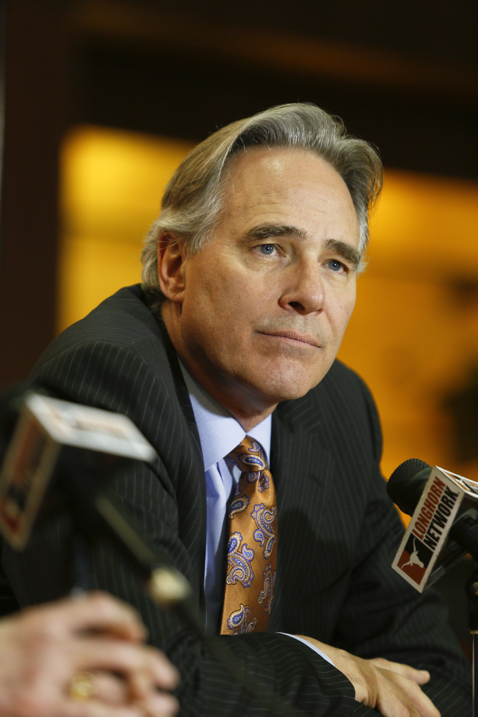 FILE - In this Dec. 15, 2013, file photo, University of Texas athletic director Steve Patterson discusses the search for a new head football coach during a news conference in Austin, Texas.  A person with direct knowledge of the decision says Texas athlet
