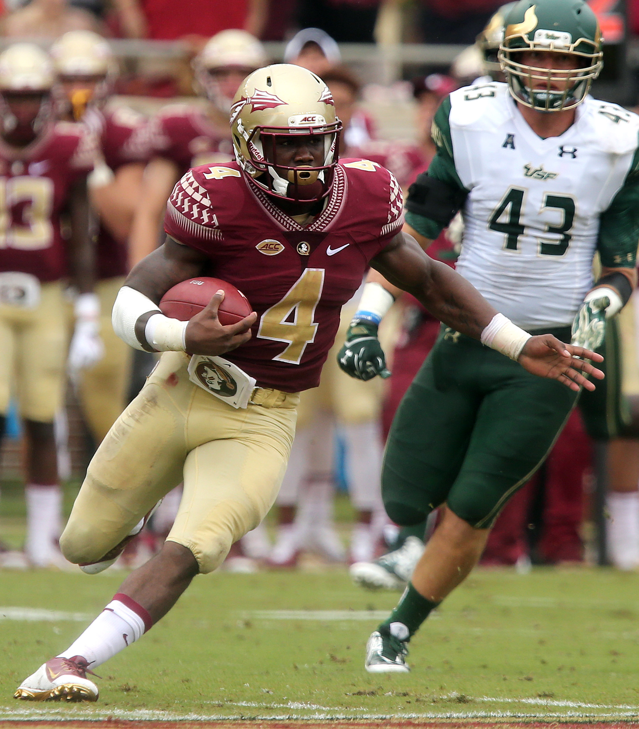 FILE - In this Saturday, Sept. 12, 2015, file photo, Florida State's Dalvin Cook,  left, scampers 74 yards for a touchdown against South Florida during the first quarter of an NCAA college football game in Tallahassee, Fla.  After an offseason where many
