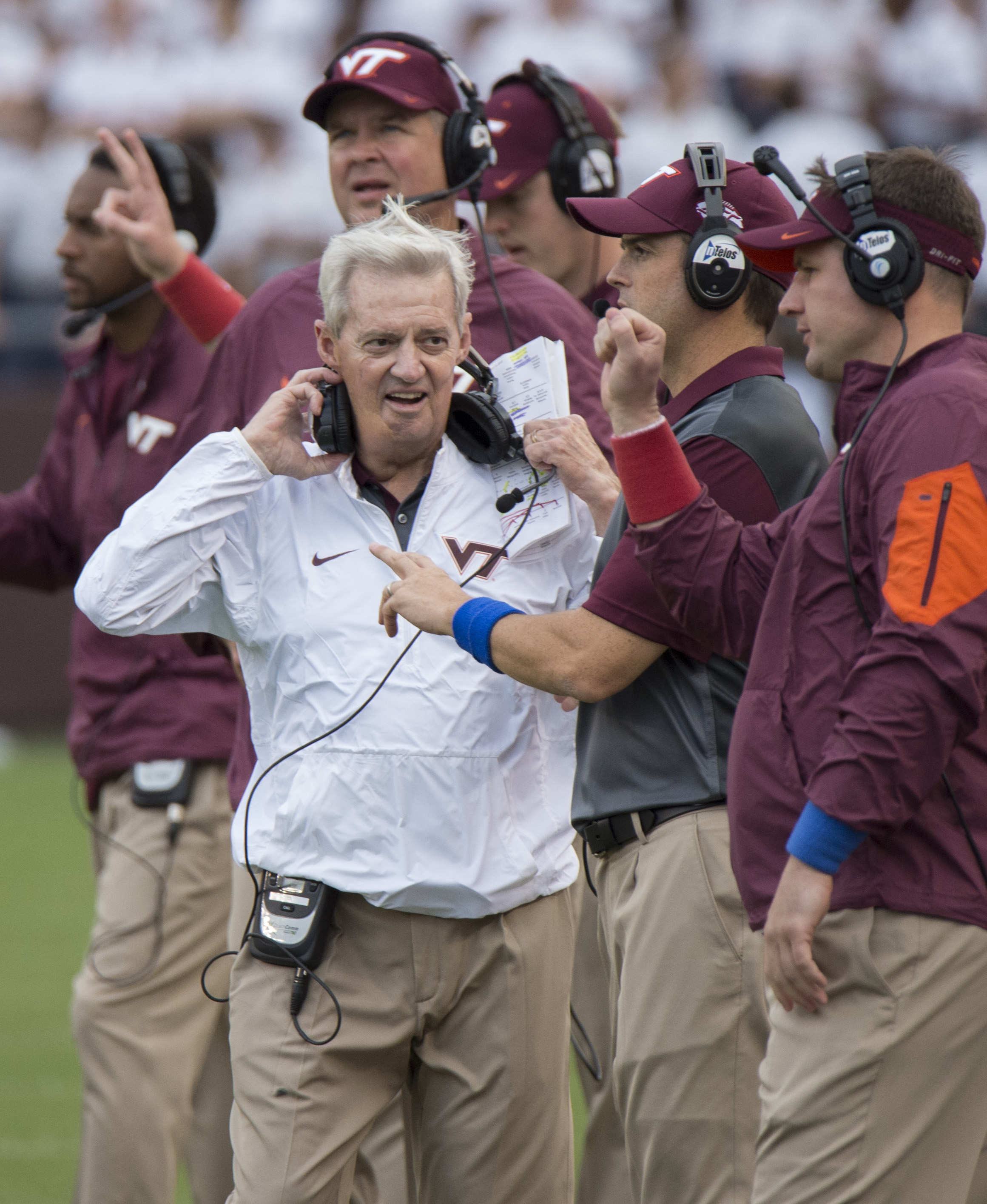FILE - In this Sept. 12, 2015 file photo, Virginia Tech's head coach Frank Beamer, center, smiles with his coaches during an NCAA college football game against Furman, at Lane Stadium in Blacksburg, Va. Beamer is Virginia Tech football. He has been head c