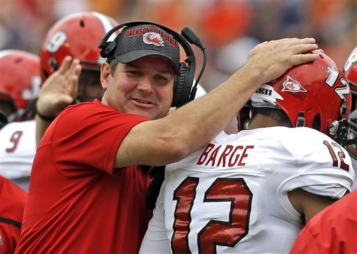 Jacksonville State head coach John Grass congratulates wide receiver Josh Barge (12) after he scored a touchdown during the first half of an NCAA college football game against Auburn, Saturday, Sept. 12, 2015, in Auburn, Ala. (AP Photo/Butch Dill)