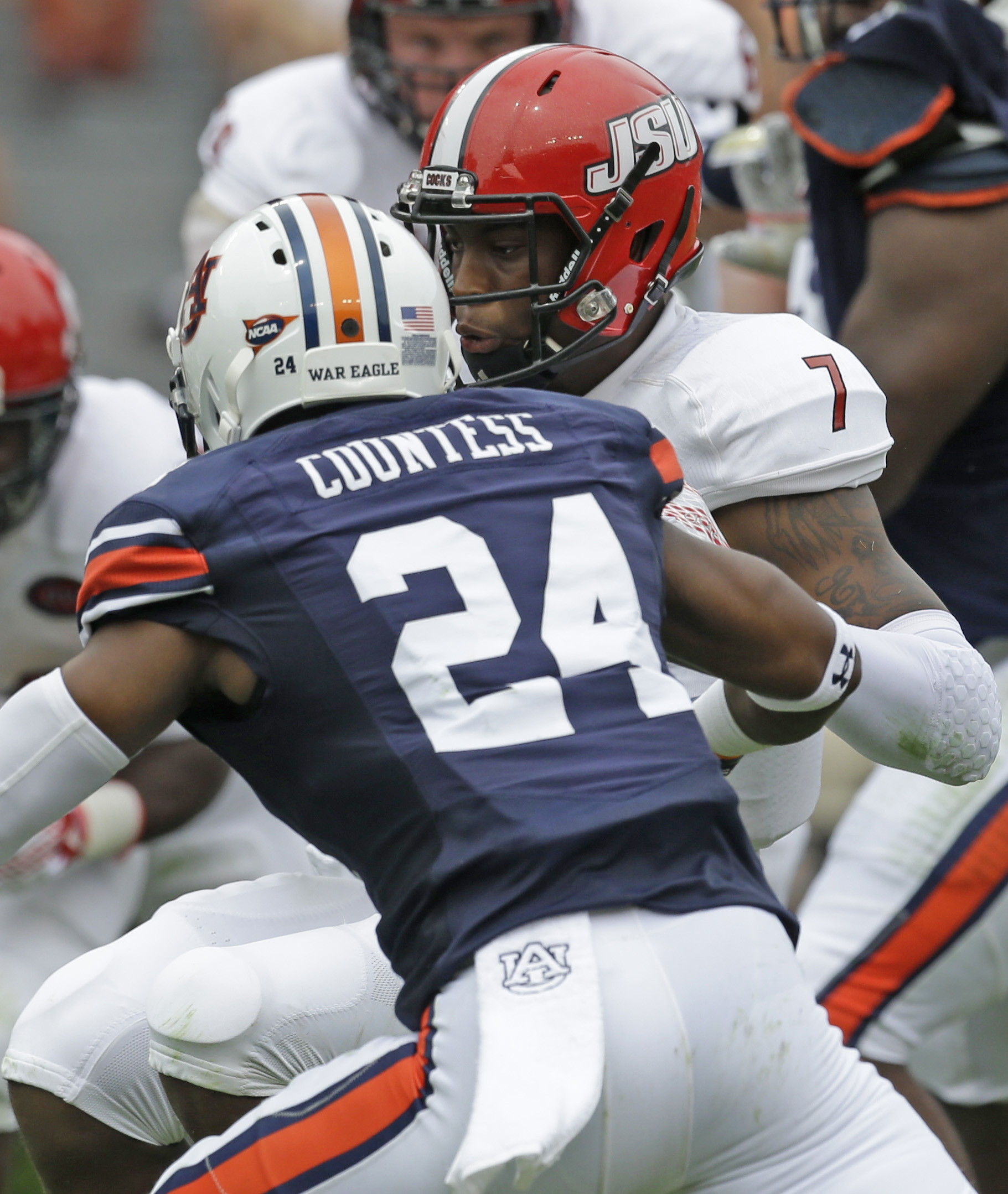 FILE - In this Saturday, Sept. 12, 2015, file photo, Auburn defensive back Blake Countess (24) is called for targeting on this hit to Jacksonville State quarterback Eli Jenkins (7) during the first half of an NCAA college football game in Auburn, Ala. The