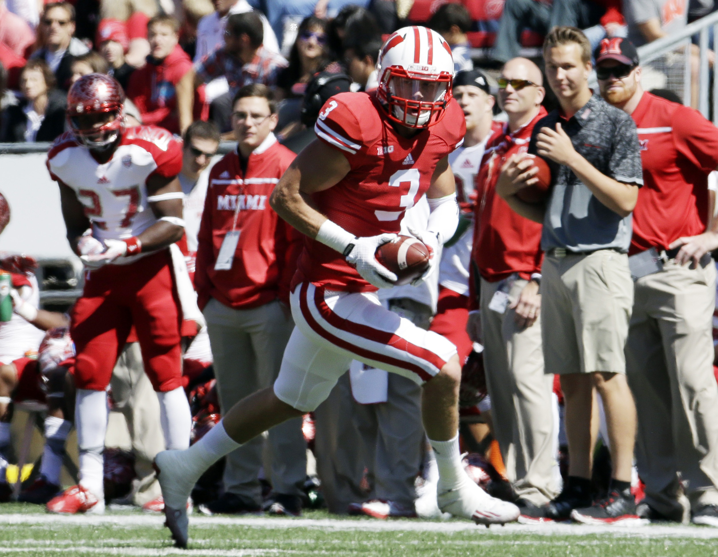 FILE - In this Saturday, Sept. 12, 2015, file photo, Wisconsin's Tanner McEvoy runs after intercepting a pass during the first half of an NCAA college football game against Miami of Ohio in Madison, Wis. McEvoy had an overwhelmingly positive debut last we