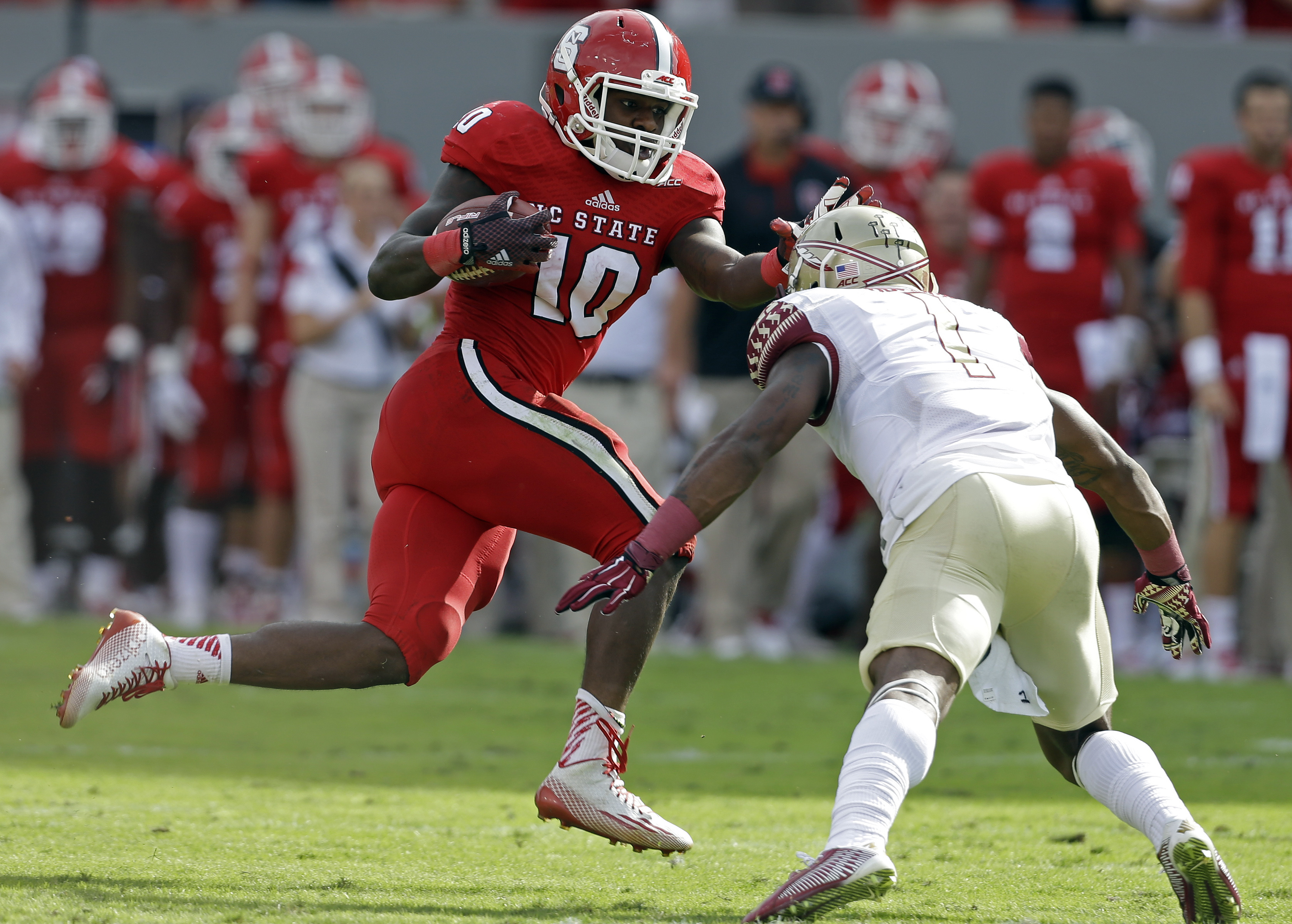 FILE - In this Sept. 27, 2014, file photo, Florida State's Tyler Hunter (1) looks to tackle North Carolina State's Shadrach Thornton (10) during the first half of an NCAA college football game in Raleigh, N.C. Thornton is eligible to return Saturday again