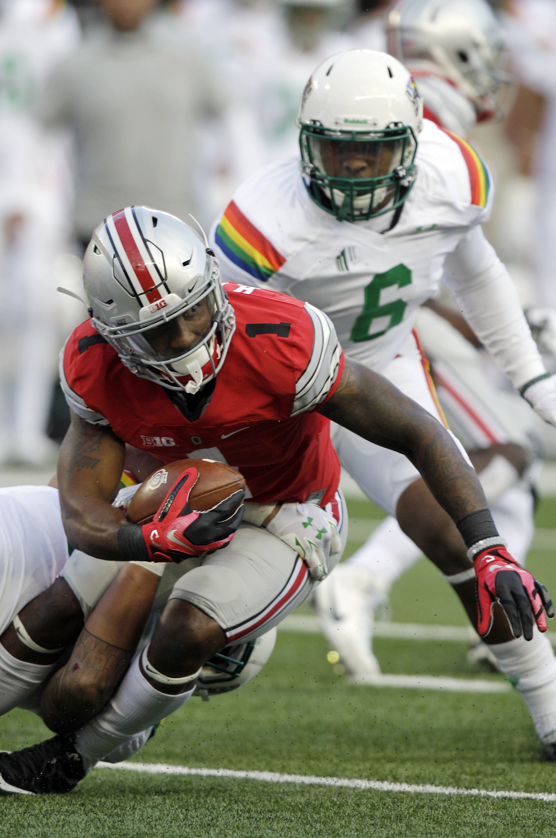 FILE - In this Saturday, Sept. 12, 2015, file photo, Ohio State receiver Braxton Miller carries the ball against Hawaii during an NCAA college football game in Columbus, Ohio. Ohio State coach Urban Meyer devised an offense in which some receivers are not