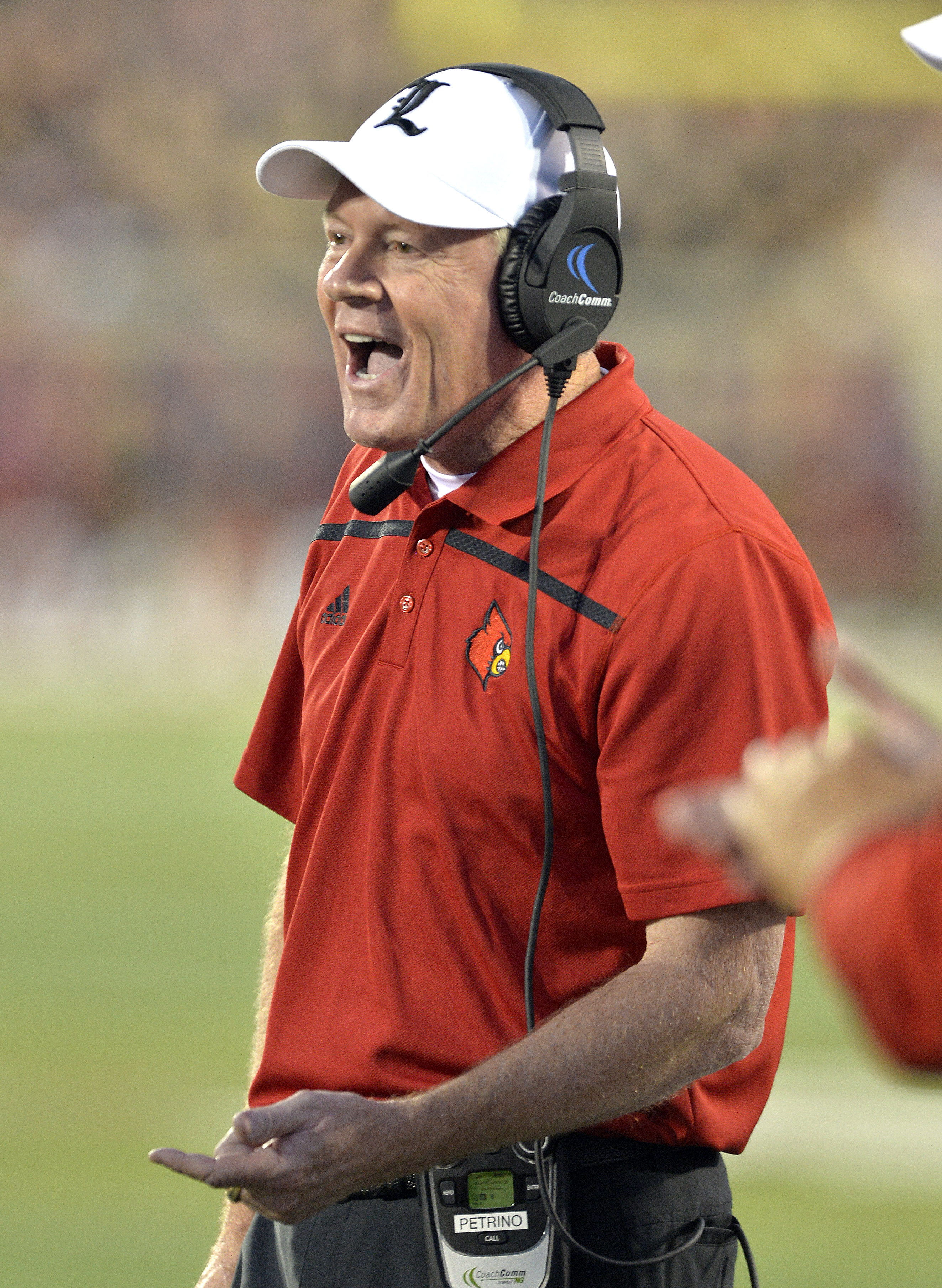 Louisville coach Bobby Petrino shouts instructions to his offense during the first half of an NCAA college football game against Clemson in Louisville, Ky., Thursday, Sept. 17, 2015. (AP Photo/Timothy D. Easley)