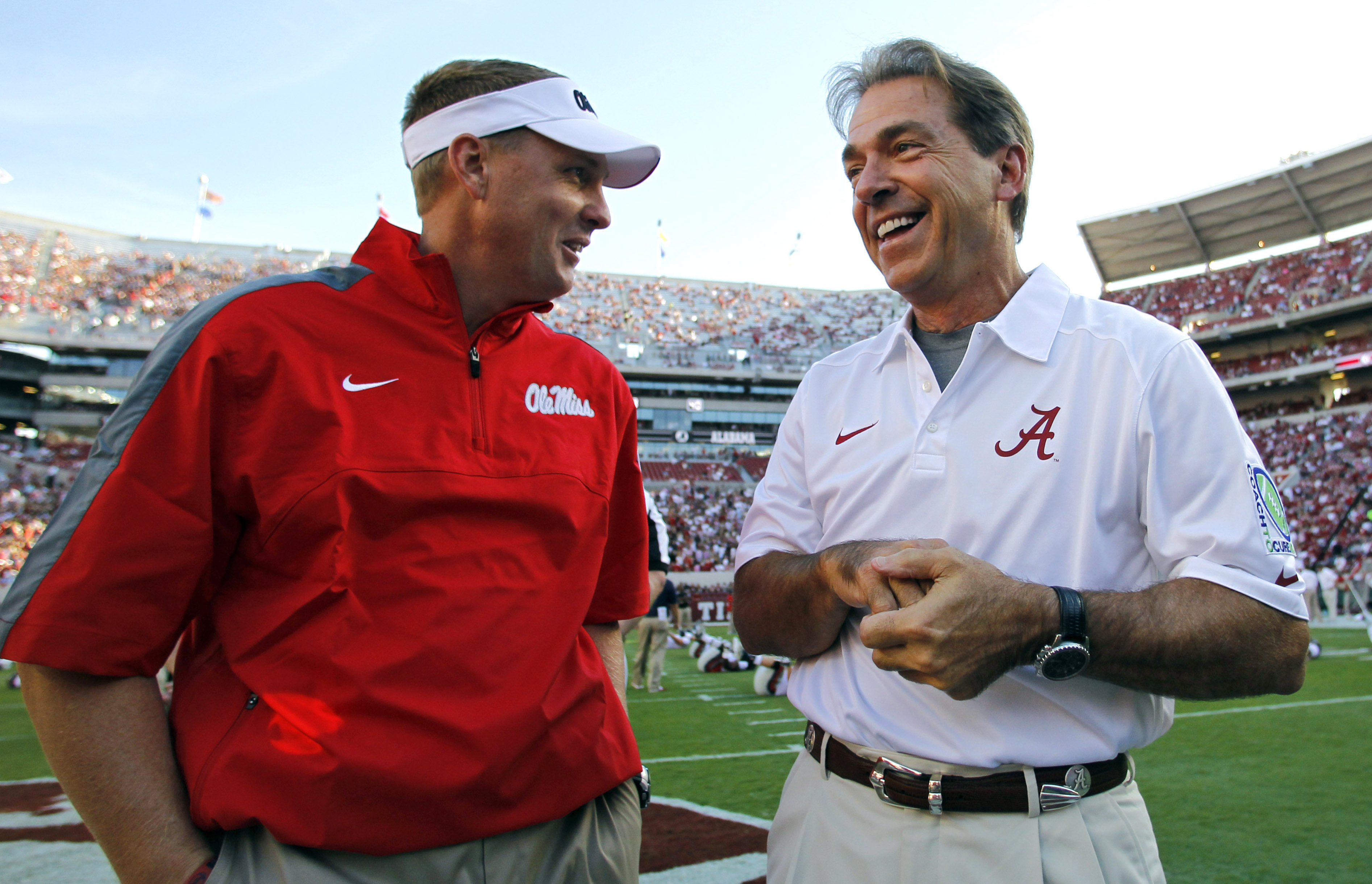 FILE - In this Sept. 28, 2013, file photo, Alabama head coach Nick Saban talks with Mississippi head coach Hugh Freeze before an NCAA college football game in Tuscaloosa, Ala. The 15th-ranked Rebels and No. 2 Alabama take center stage in Tuscaloosa on Sat
