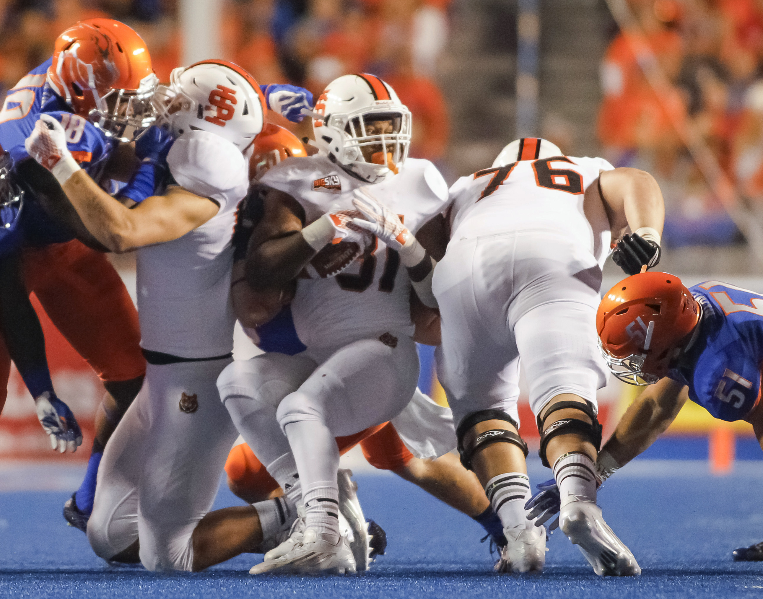 Idaho State running back Xavier Finney (31) gets spun around with the ball during the first half of an NCAA college football game against Boise State in Boise, Idaho, on Friday, Sept. 18, 2015. (AP Photo/Otto Kitsinger)