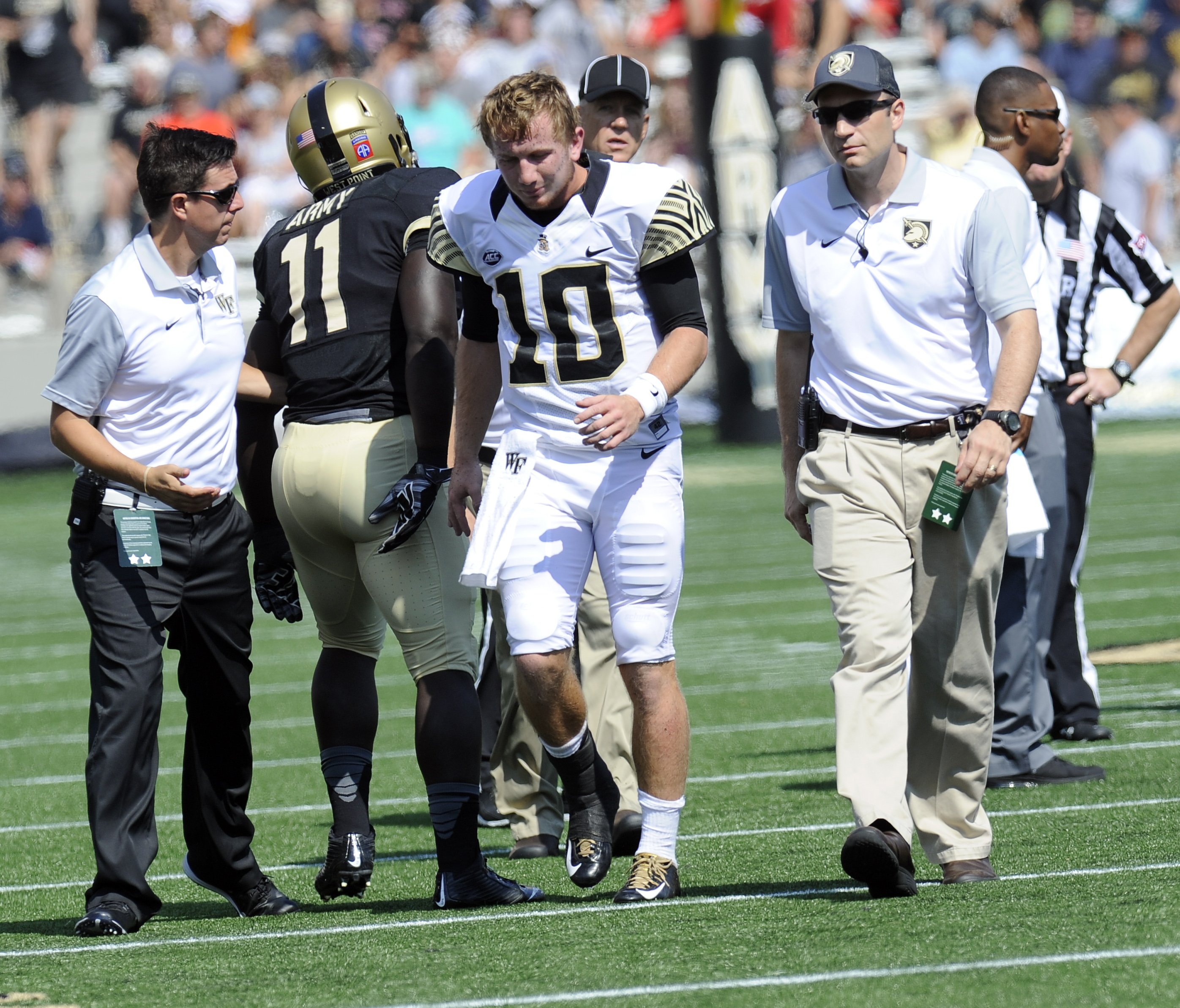 Wake Forest quarterback John Wolford (10) leaves the game limping later to return while playing against Army during an NCAA college football game on Saturday, Sept. 19, 2015, in West Point, N.Y. (AP Photo/Hans Pennink)
