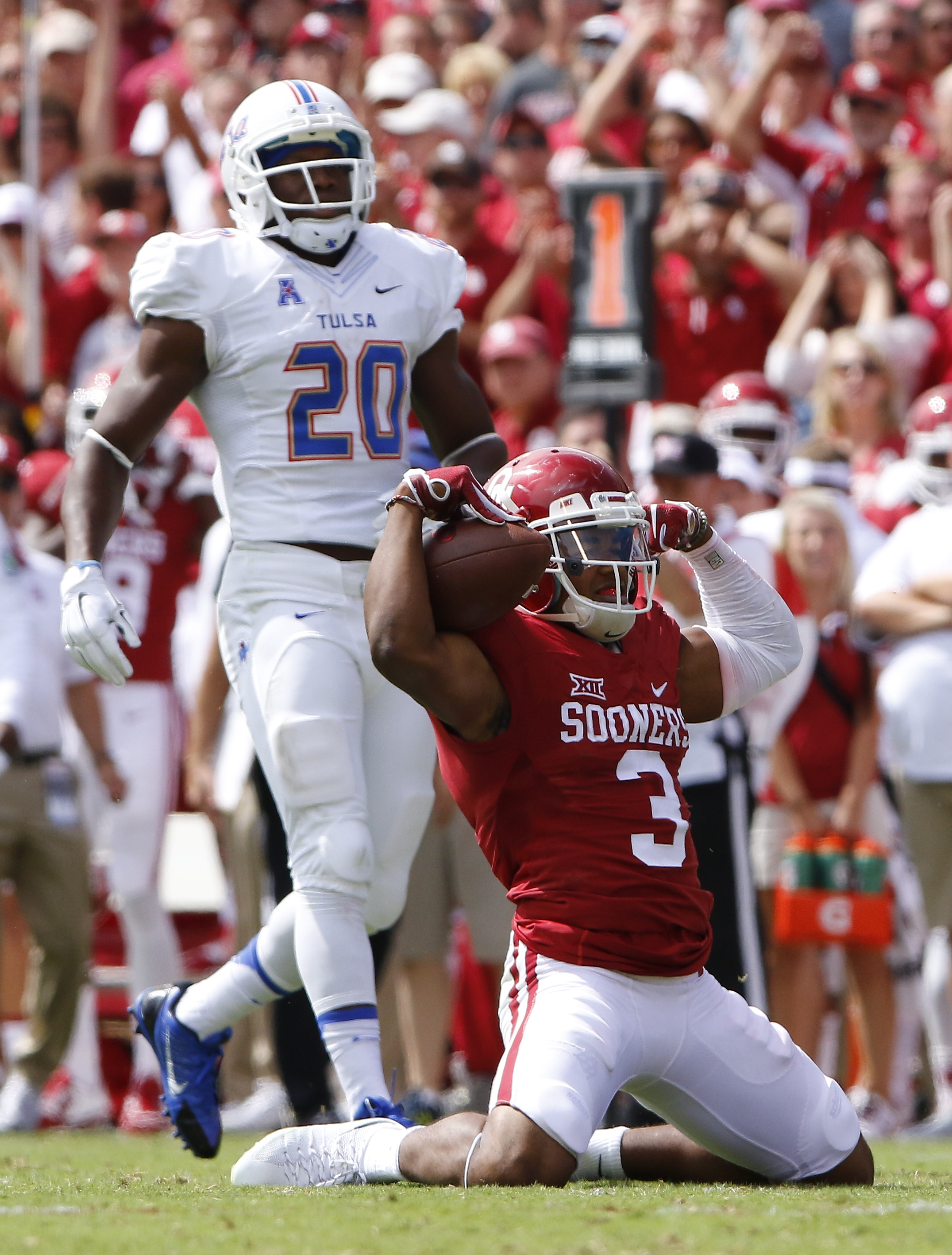 Oklahoma wide receiver Sterling Shepard (3) celebrates after making a catch against Tulsa and is hit with an unsportsmanlike conduct penalty during the second quarter of an NCAA college football game in Norman, Okla., Saturday, Sept. 19, 2015. (AP Photo/A