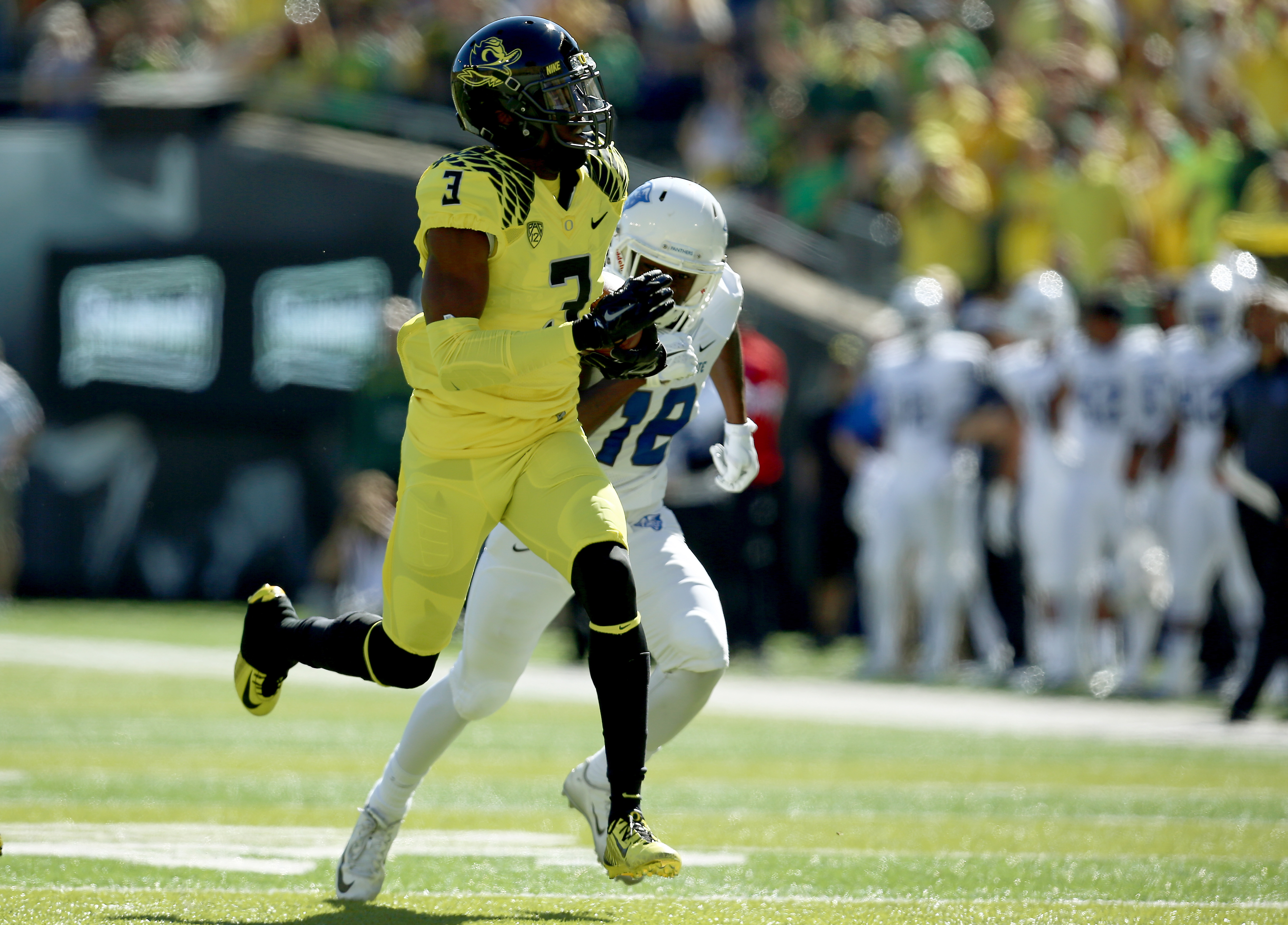 Oregon safety Tyree Robinson (3) returns an interception during the first quarter of an NCAA college football game against Georgia State, Saturday, Sept. 19, 2015, in Eugene, Ore. (AP Photo/Ryan Kang)