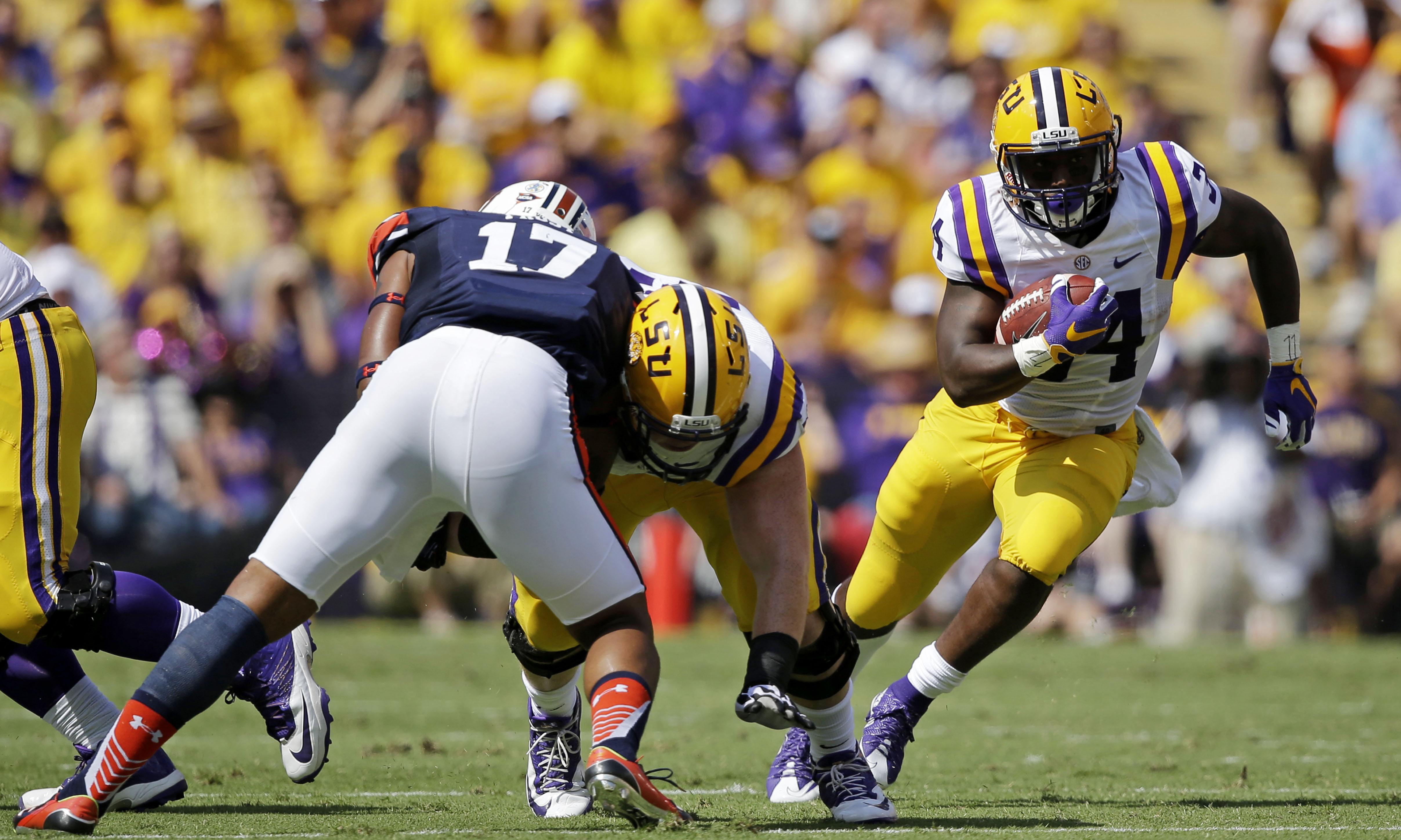 LSU running back Darrel Williams (34) carries past Auburn linebacker Kris Frost (17) in the first half of an NCAA college football game in Baton Rouge, La., Saturday, Sept. 19, 2015. (AP Photo/Gerald Herbert)