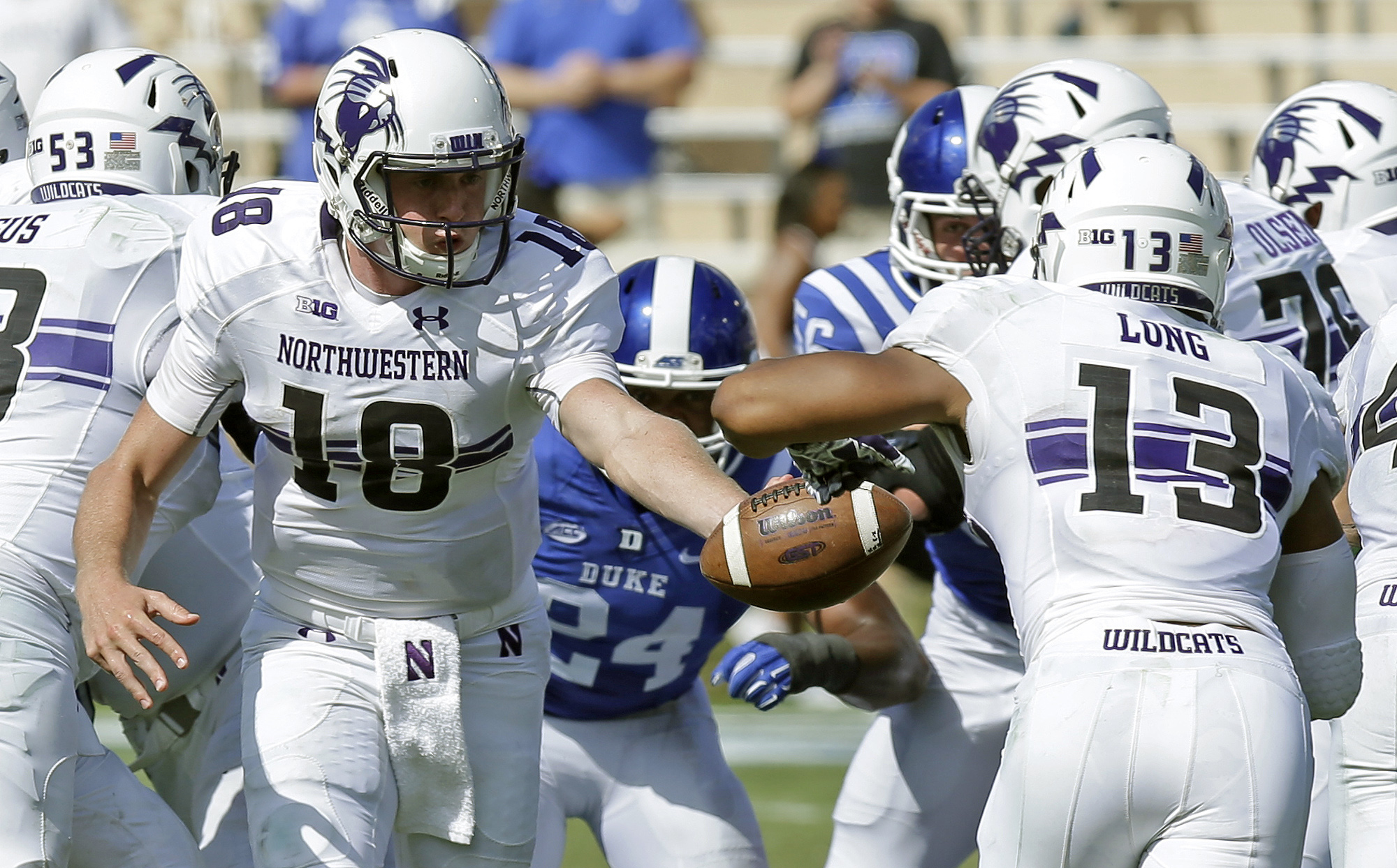 Northwestern quarterback Clayton Thorson hands off to Warren Long (13) during the second half of an NCAA college football game against Duke in Durham, N.C., Saturday, Sept. 19, 2015. Long scored a touchdown on the play. Northwestern won 19-10. (AP Photo/G
