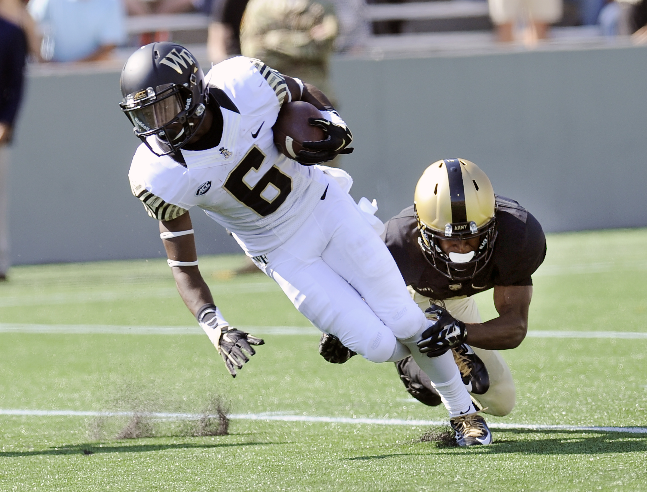 Wake Forest's Tabari Hines (6) is tackled by Army's Marcus Hyatt during the second half of an NCAA college football game on Saturday, Sept. 19, 2015, in West Point, N.Y. (AP Photo/Hans Pennink)