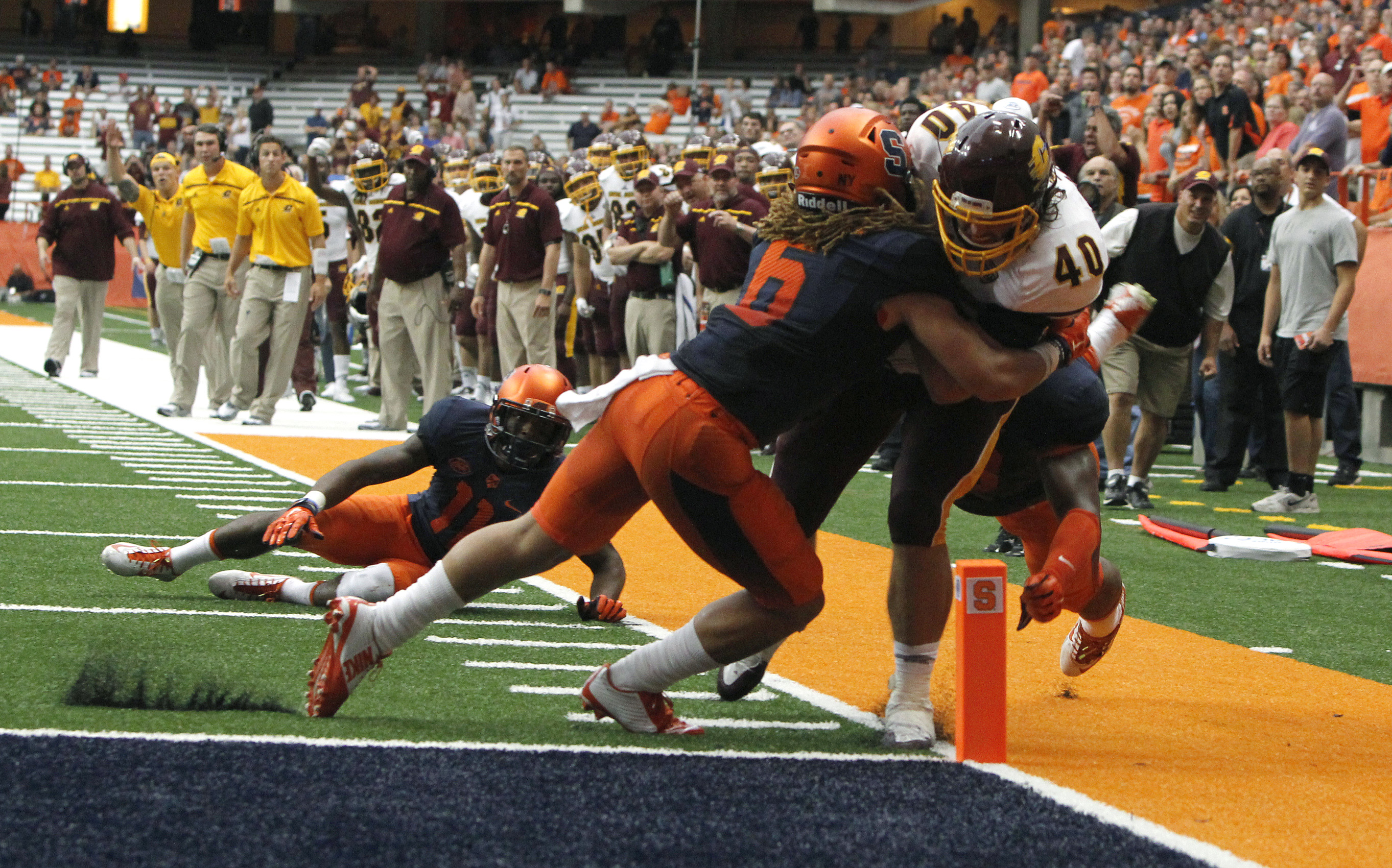 Syracuse's Rodney Williams (left) pushes Central Michigan's Joe Bacci (right) out of bounds on the one yard line in overtime of an NCAA college football game in Syracuse, N.Y., Saturday, Sept. 19, 2015. Syracuse won 30  27. (AP Photo/Nick Lisi)