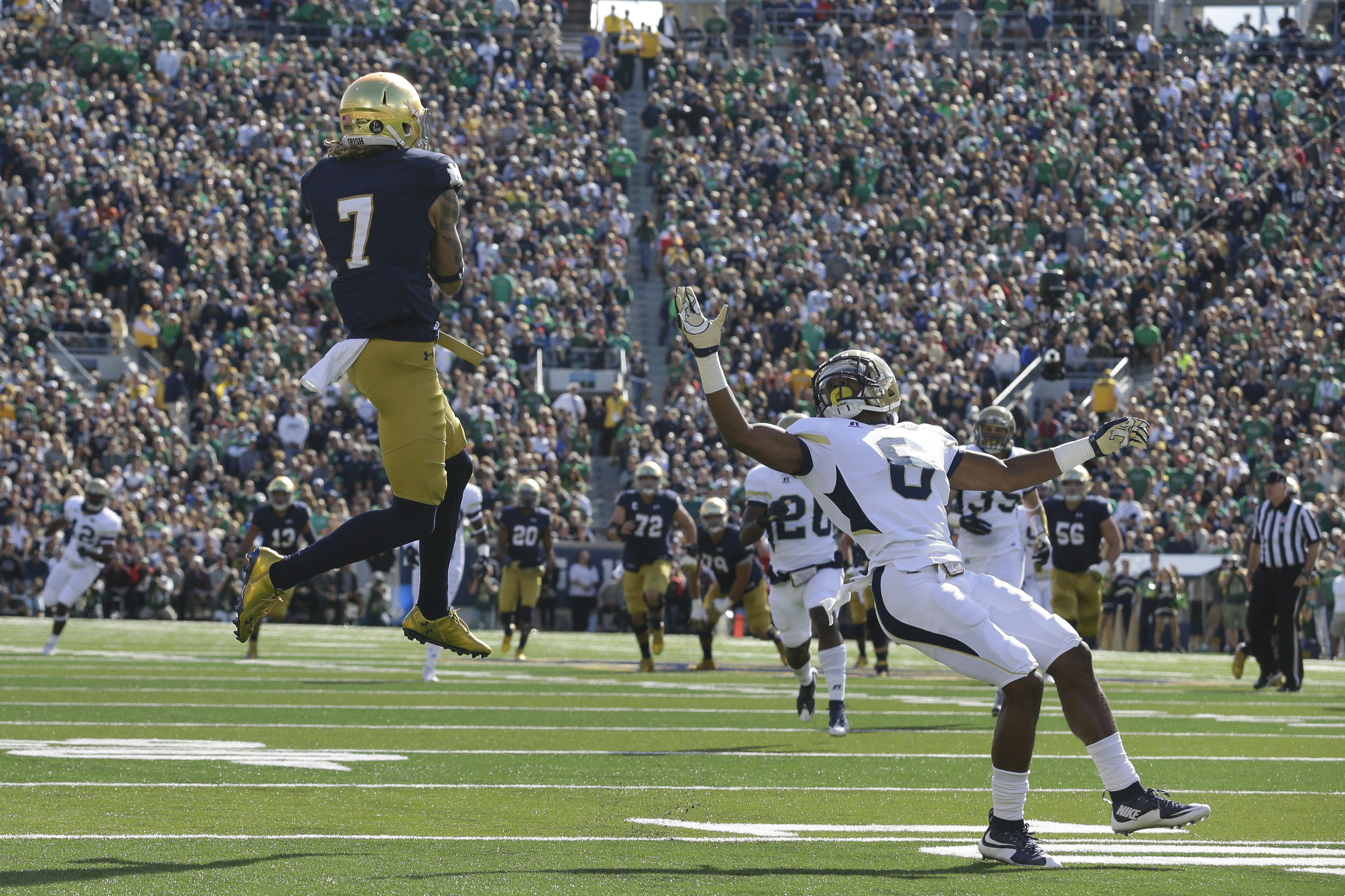 Notre Dame wide receiver Will Fuller (7) makes a catch for a touchdown over Georgia Tech defensive back Chris Milton (6) during the first half of an NCAA college football game in South Bend, Ind., Saturday, Sept. 19, 2015. (AP Photo/Michael Conroy)