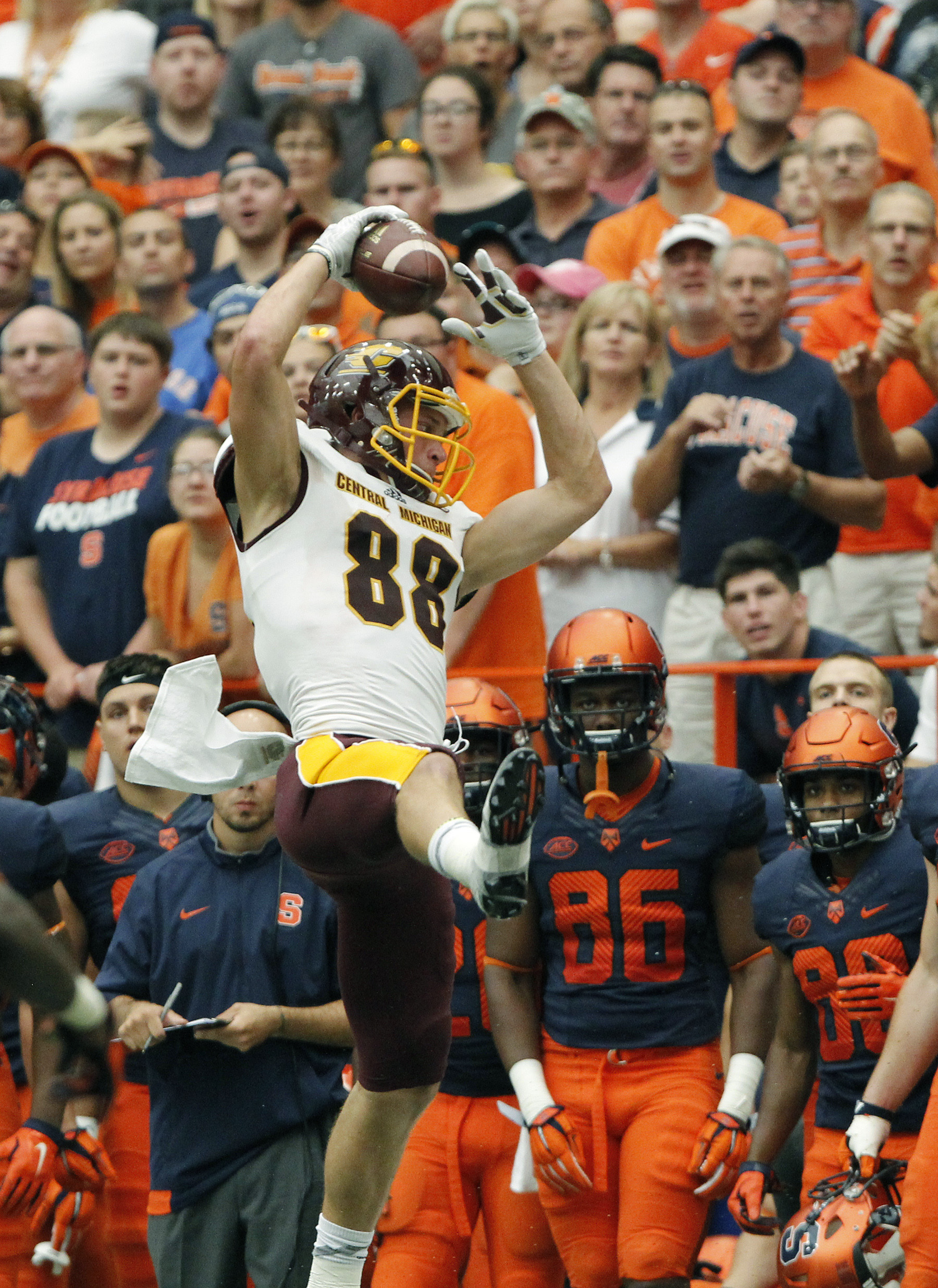 Central Michigan's Jesse Knoll makes a catch near the Syracuse bench in the second half of an NCAA college football game in Syracuse, N.Y., Saturday, Sept. 19, 2015. Syracuse won 30  27. (AP Photo/Nick Lisi)