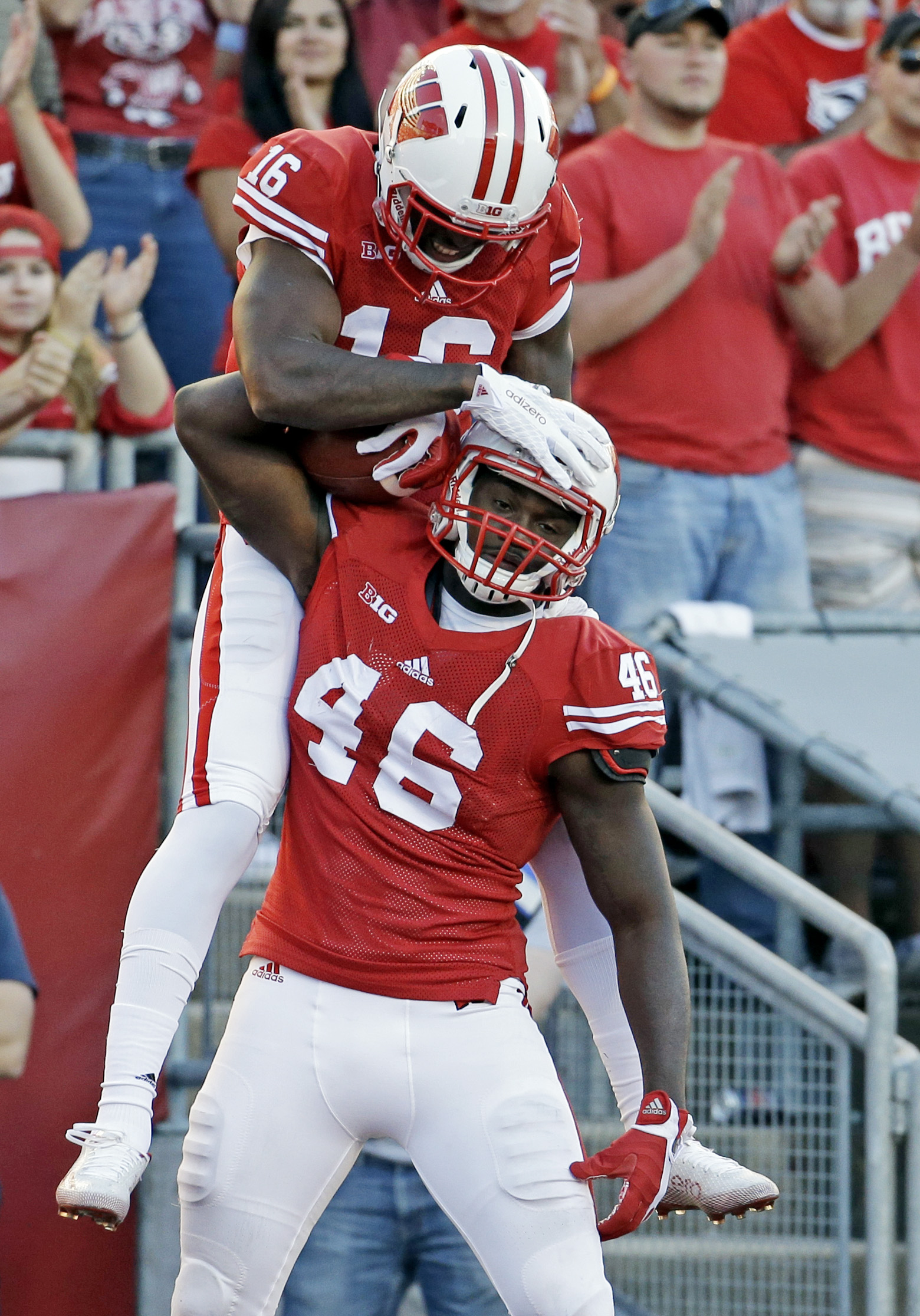 Wisconsin's Austin Traylor (46) is congratulated by teammate Reggie Love (16) after a touchdown catch during the second half of an NCAA college football game against Troy, Saturday, Sept. 19, 2015, in Madison, Wis. (AP Photo/Morry Gash)
